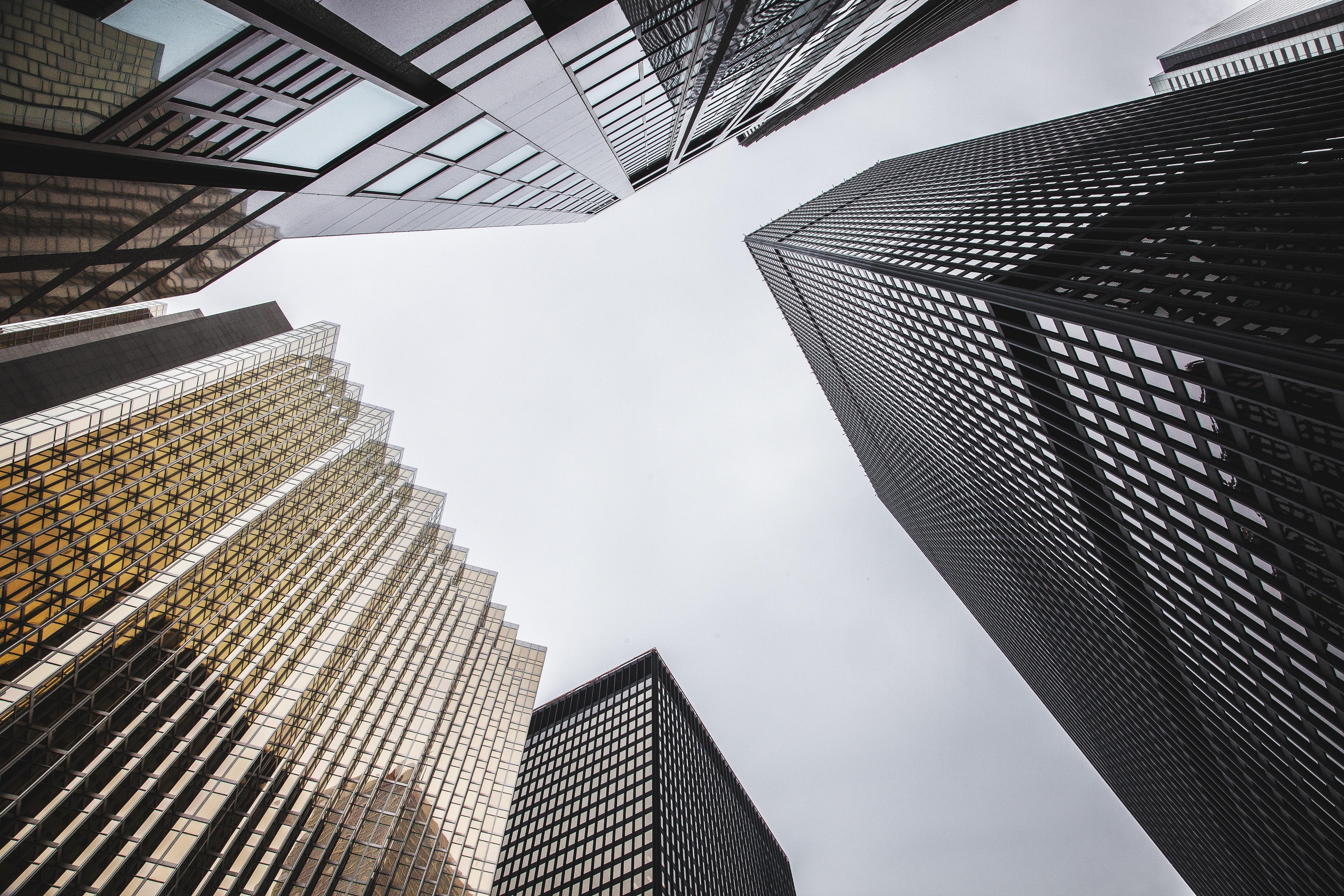 A low-angle shot of several distinct skyscraper facades in Toronto