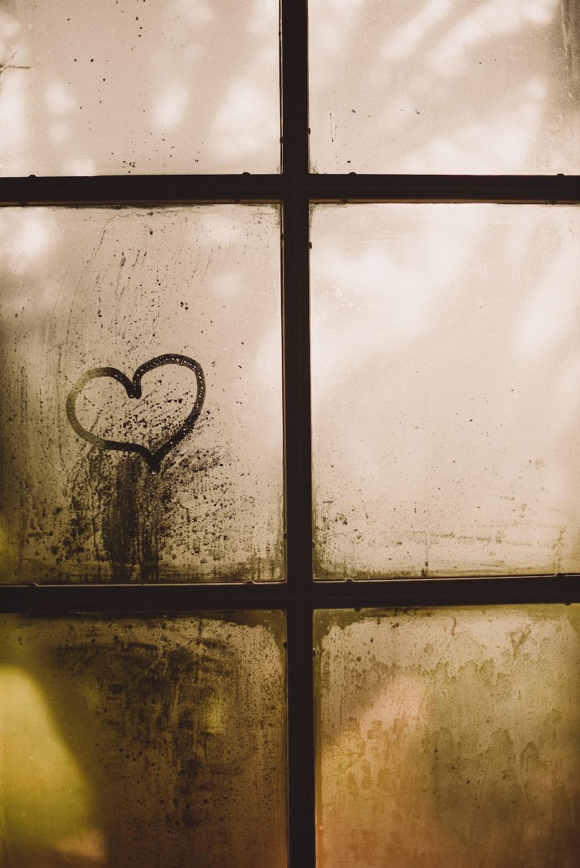 black framed glass window with heart draw