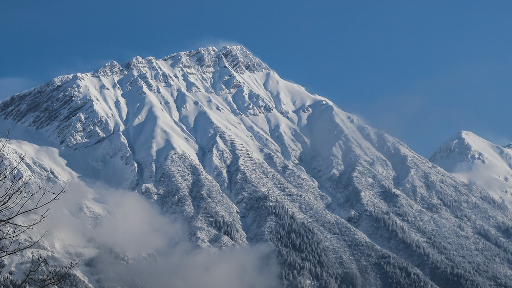 photography of snow capped mountain during daytime