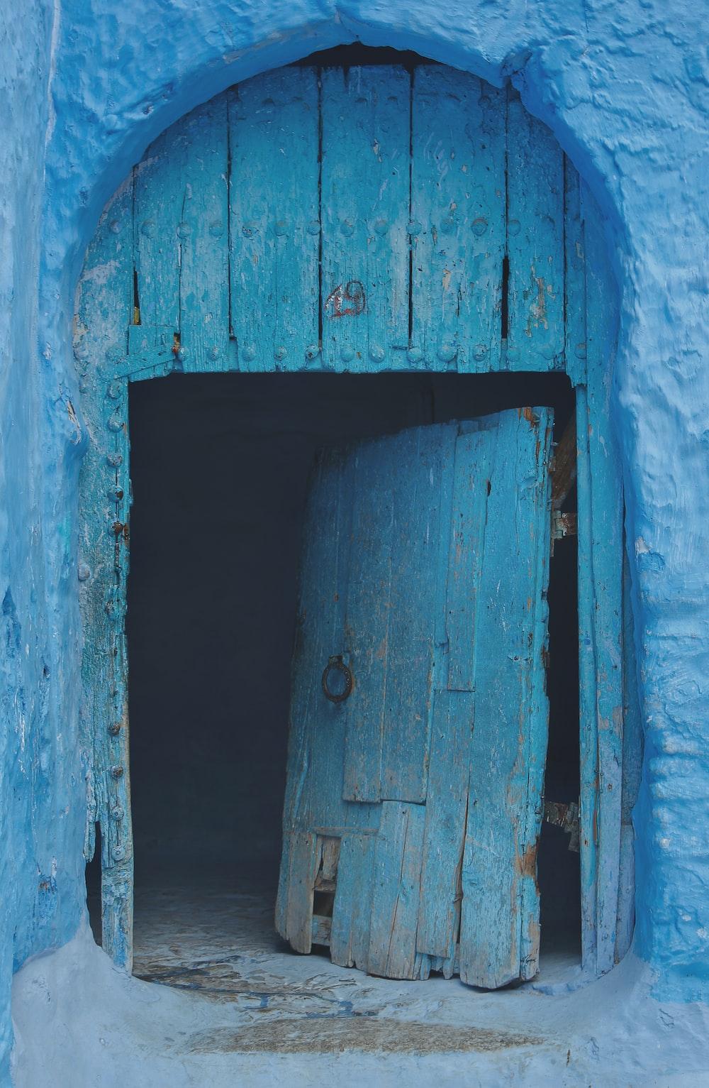 opened blue wooden door