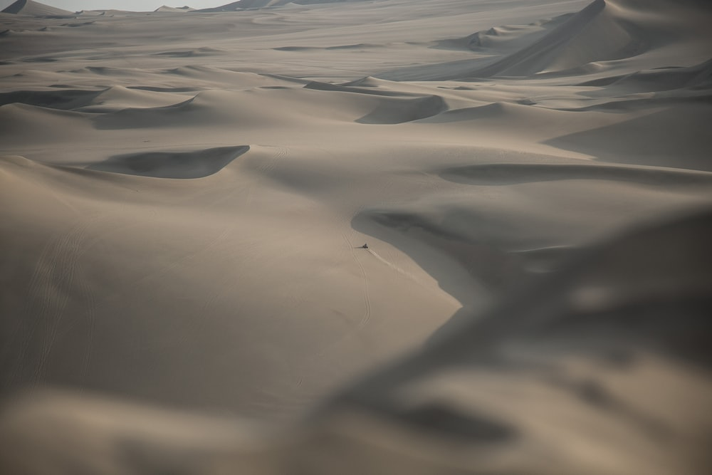 landscape photography of gray sand at desert