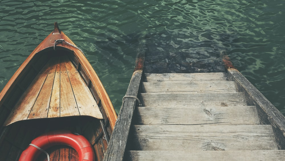 boat near wooden stairs