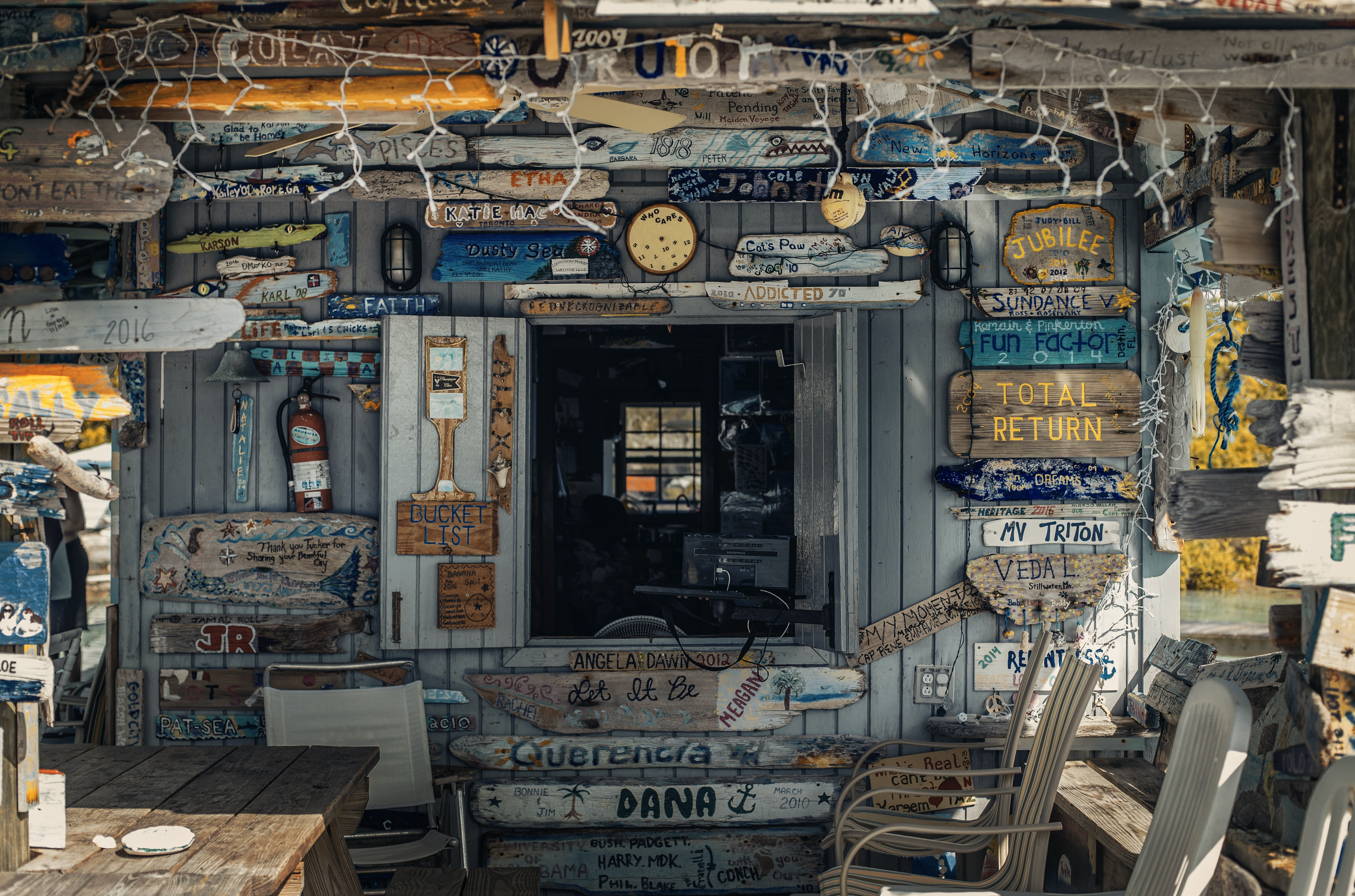 Wooden building front covered with wooden signs in Exuma