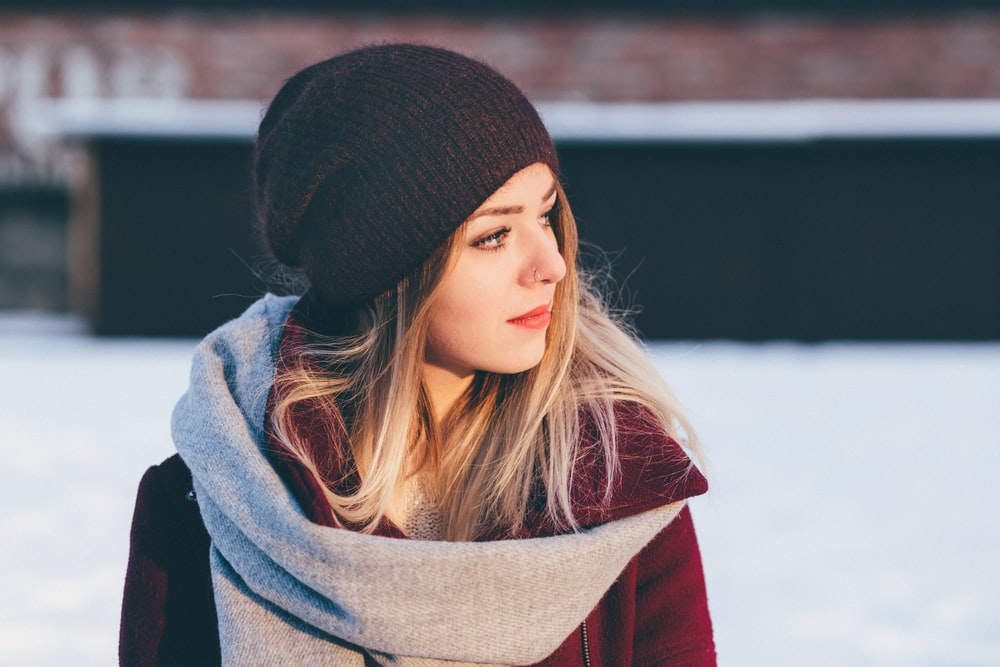 woman wearing black knitted cap