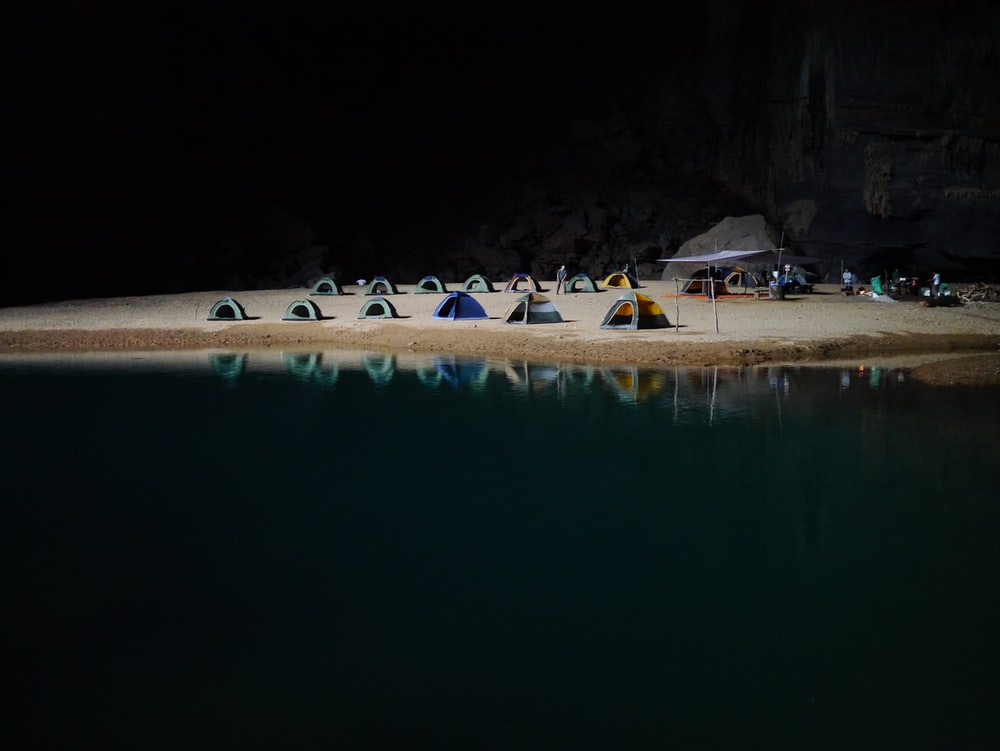 camping tents on brown sand beach
