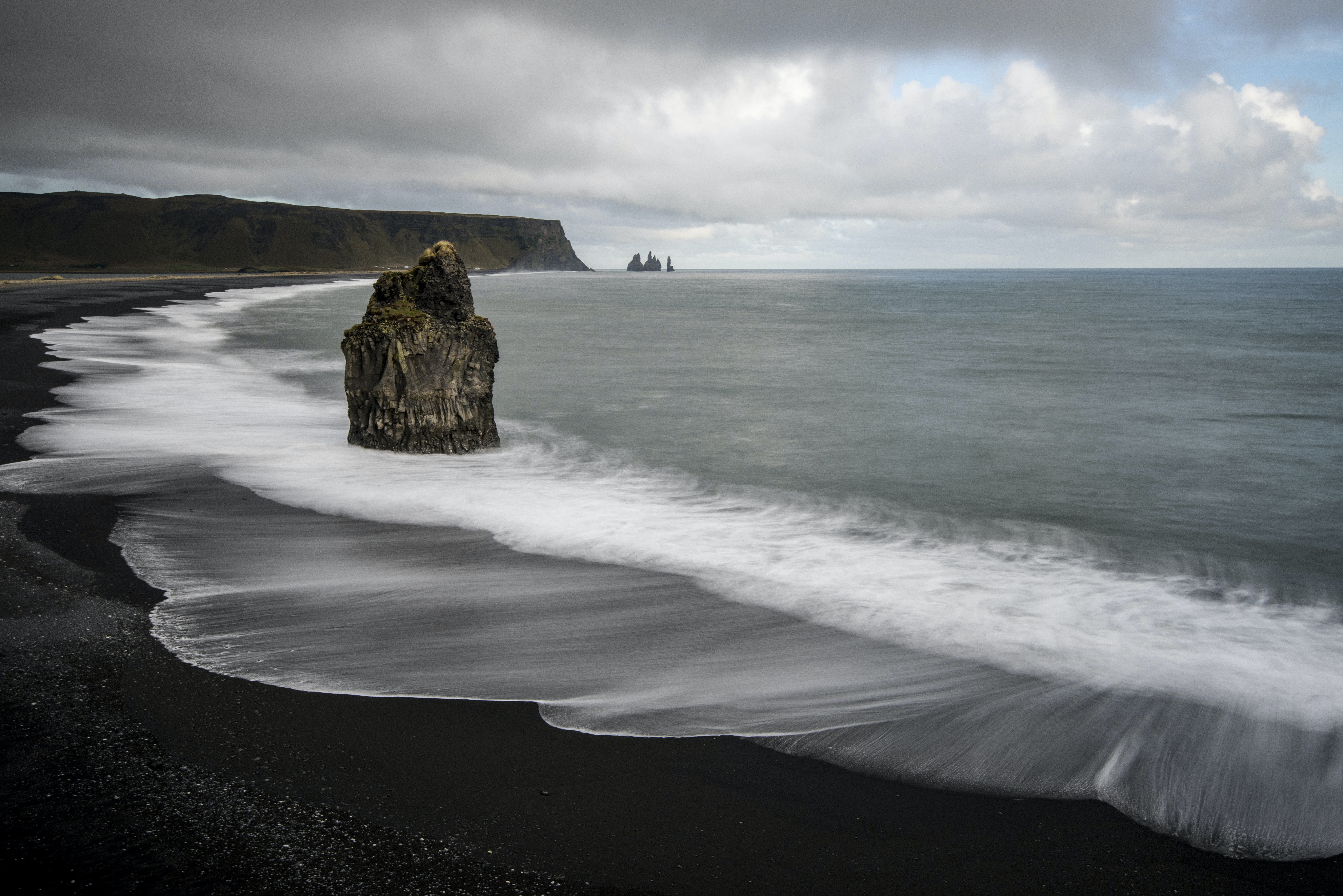 Large rock on the black sand beach in Vik