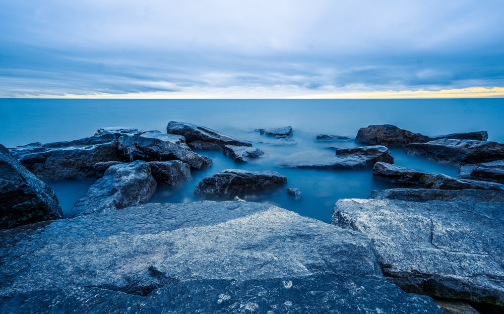 rocks and body of water during daytime