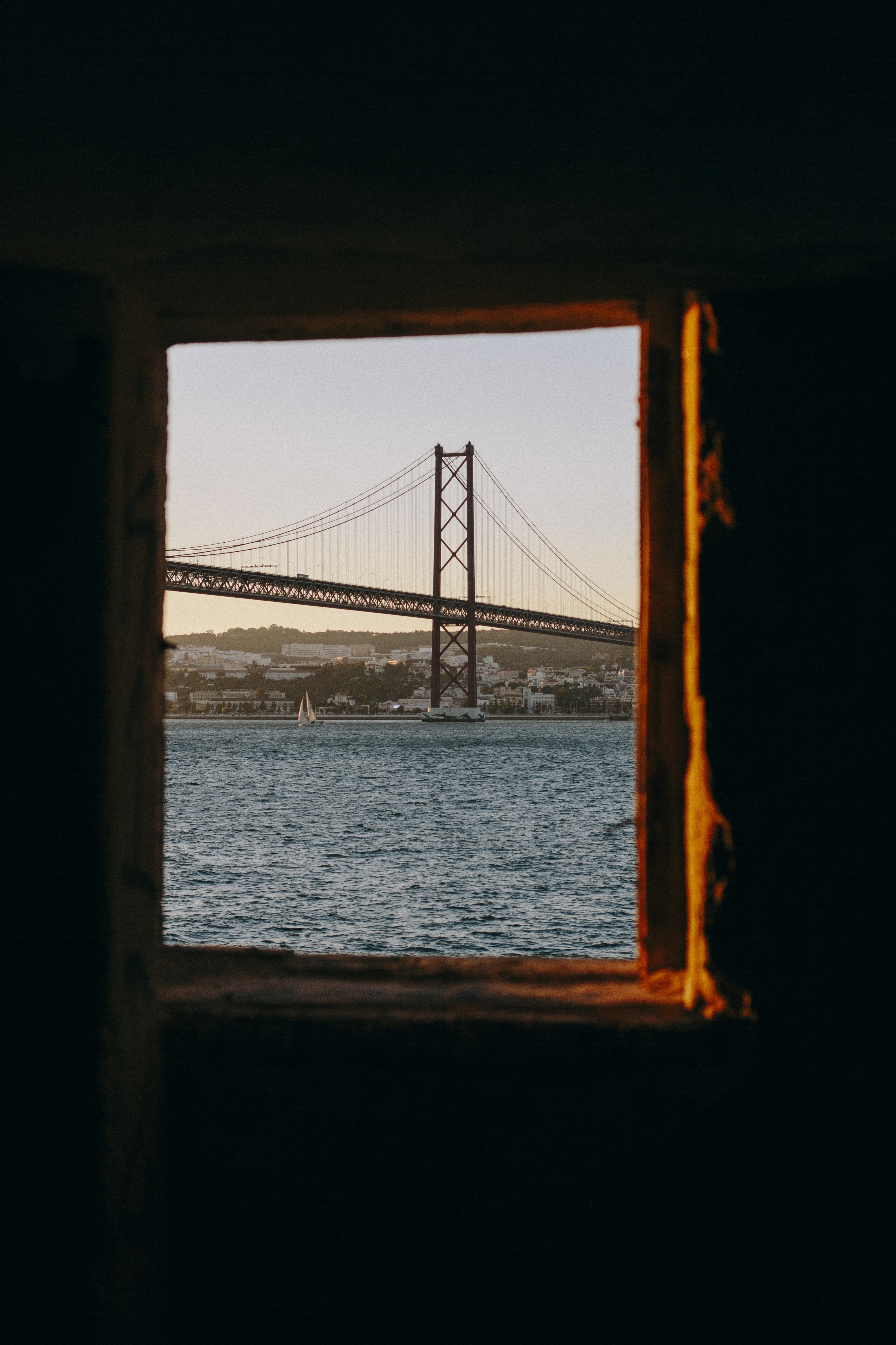 window with view of San Francisco bridge