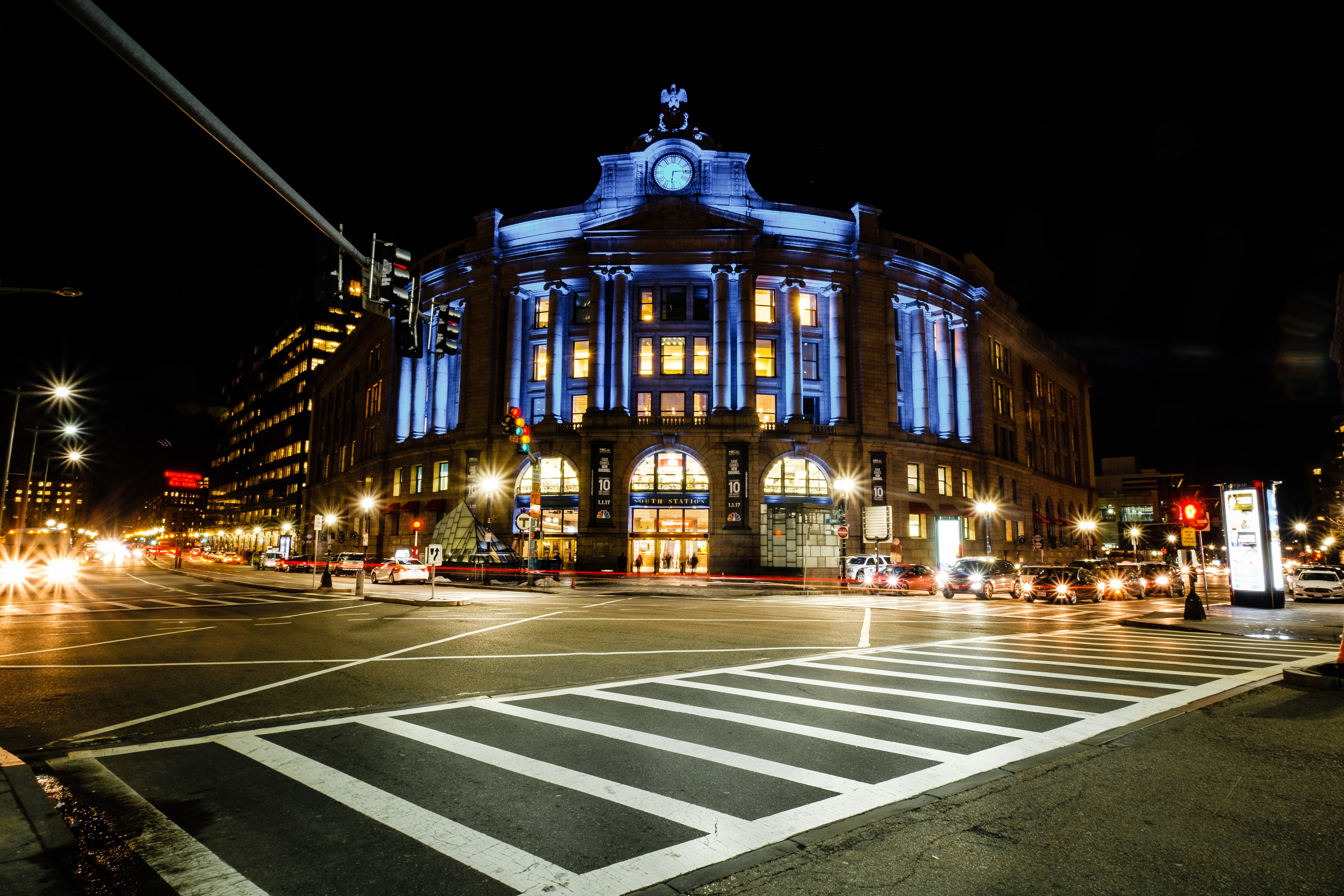 A perfect night-time image of a historic architecture in Boston, with a small clock tower
