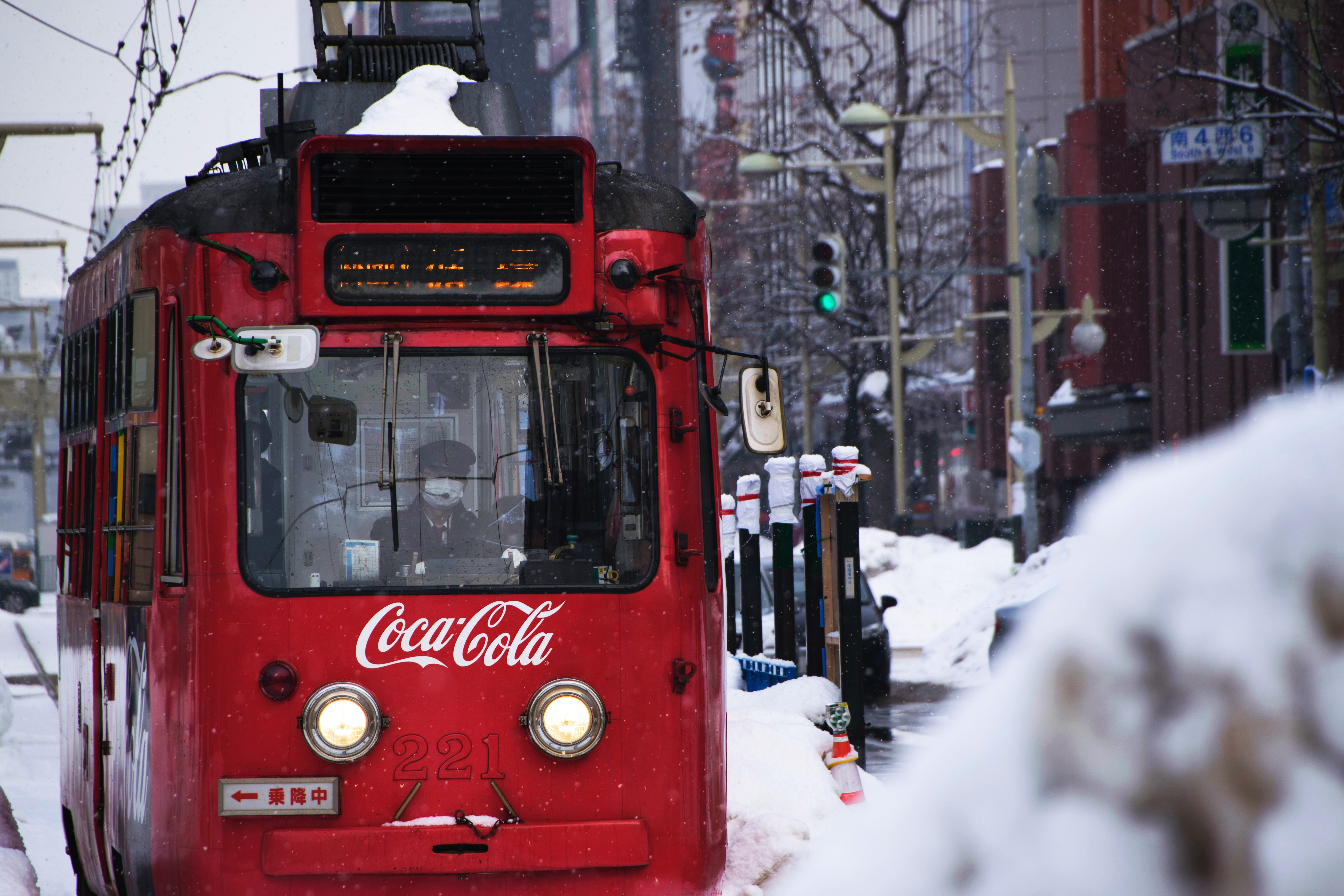 A trolleybus in Sapporo, Japan with Coca Cola branding on the front