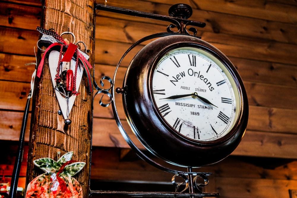 black New Orleans framed analog clock