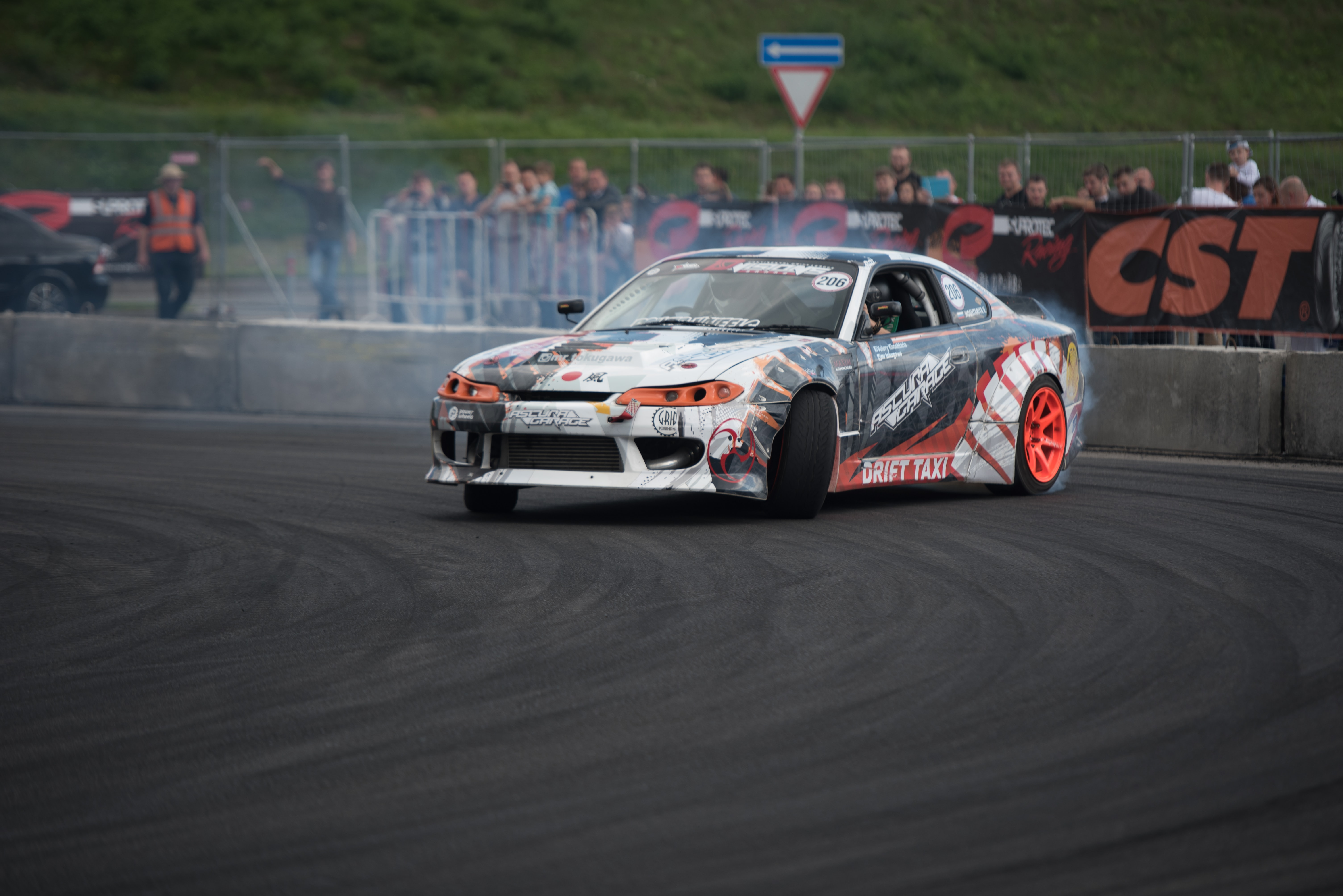 A race car drifting at fast speed along a race track
