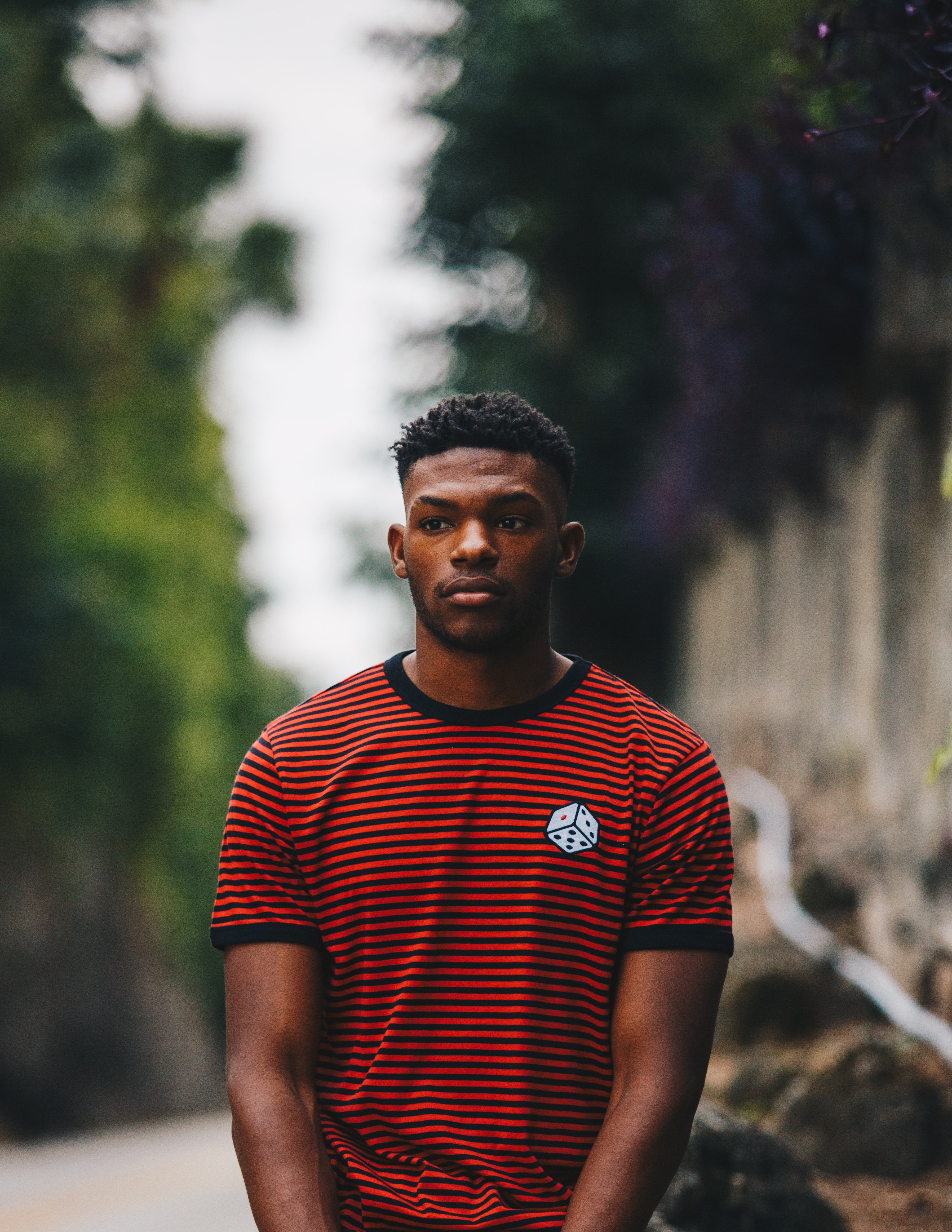 man wearing red and black striped ringer shirt