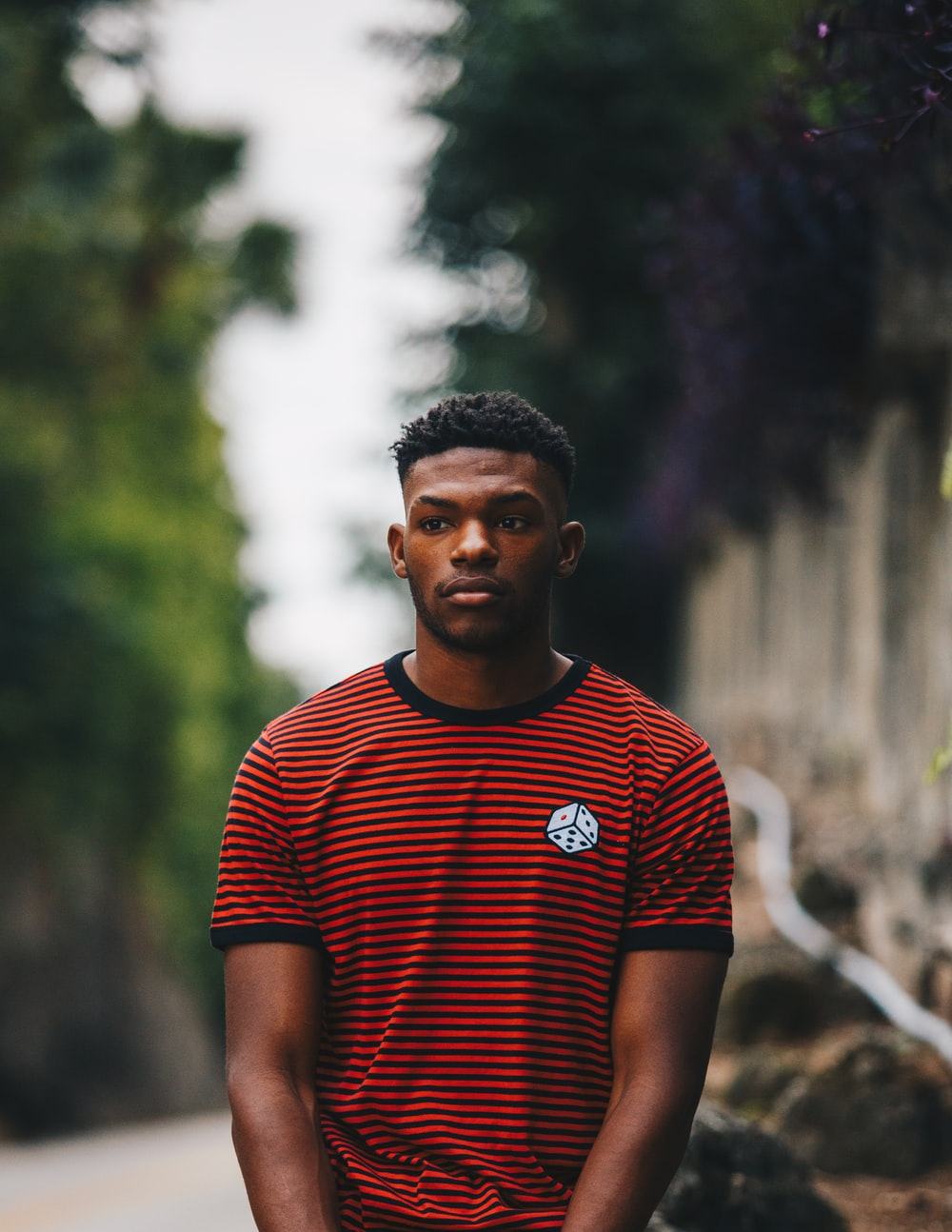 man wearing red and black striped ringer shirt