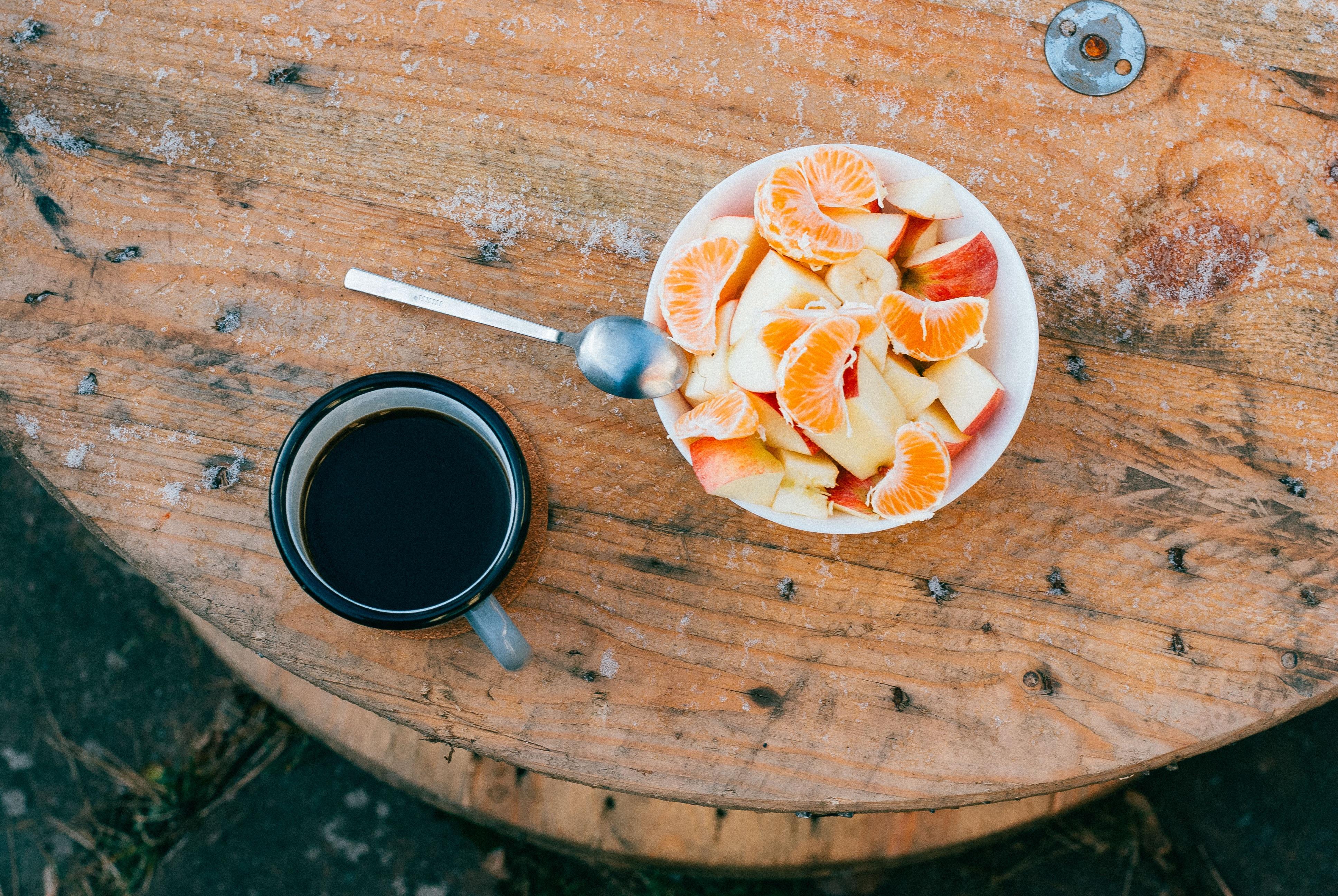 orange and apple on bowl