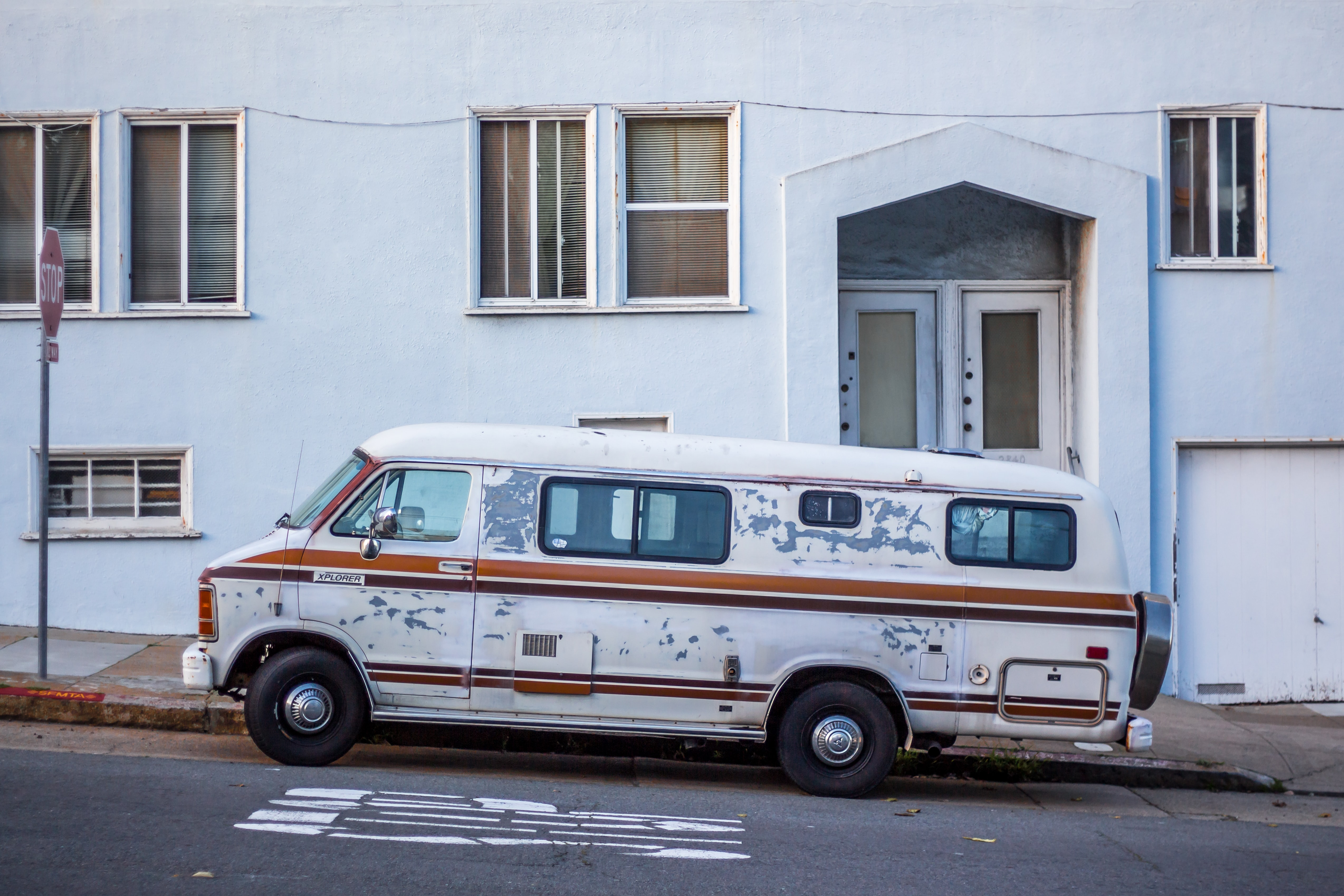 An old van parked by the curb in San Francisco.