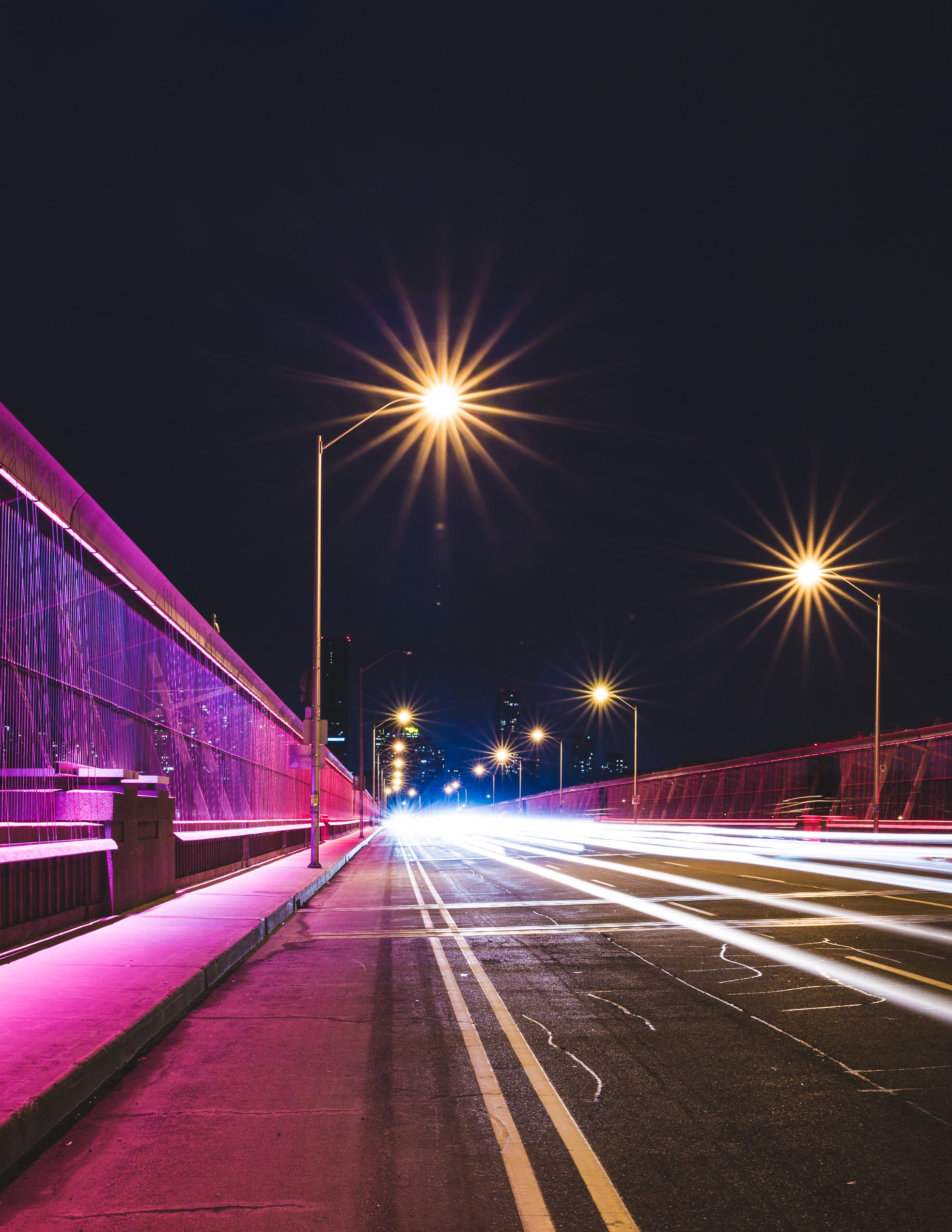 A simple photo featuring traffic light trails and street lamps on Toronto's Bloor Street East