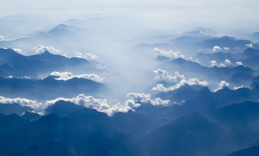 white clouds above silhouette of clouds at day