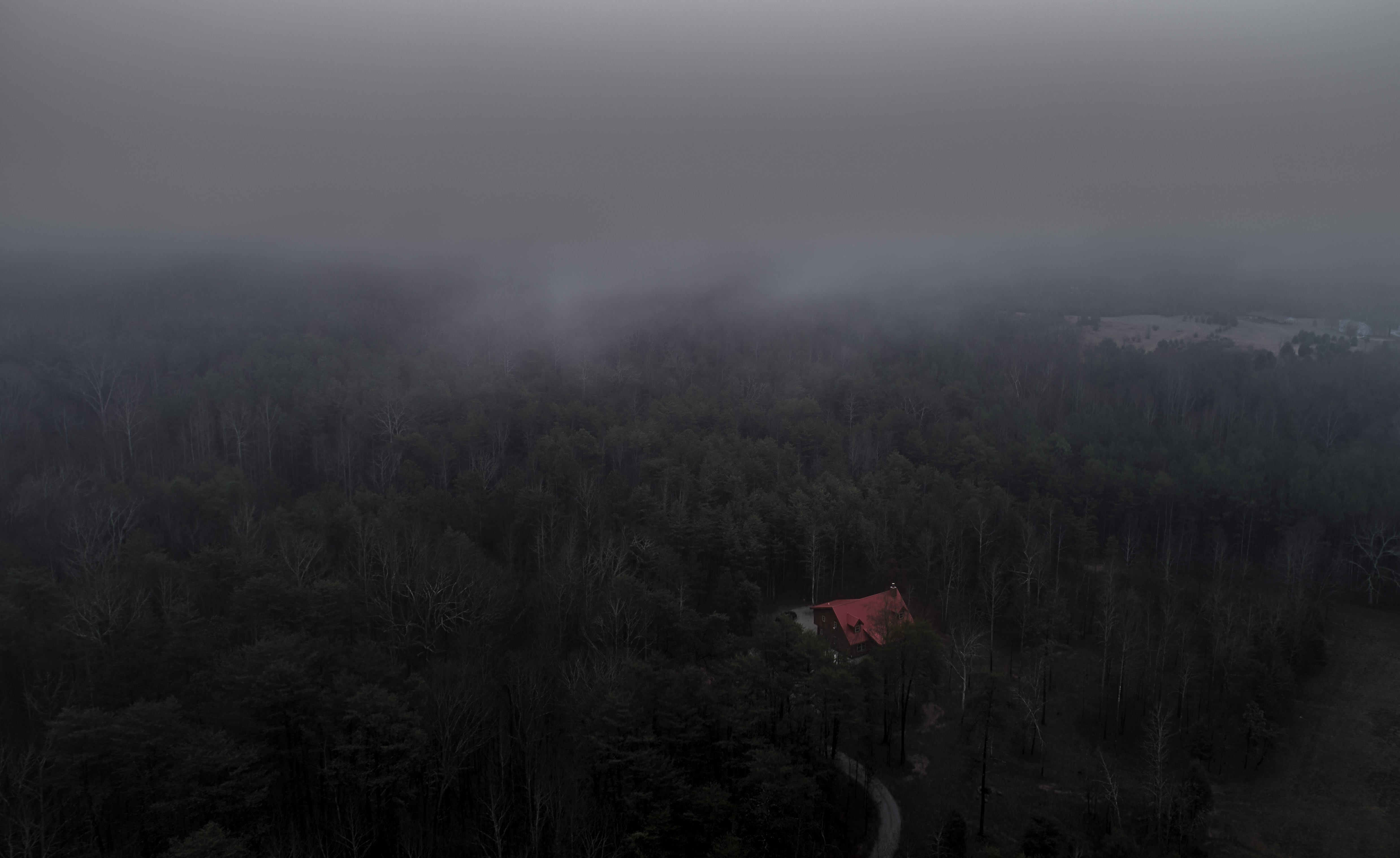 A house in the middle of the forest with trees covered by fog in LaFayette, Georgia, United States