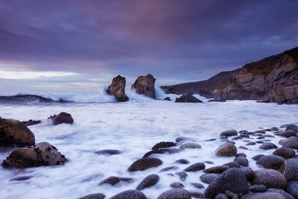 photo of rocky beach during cloudy daytime