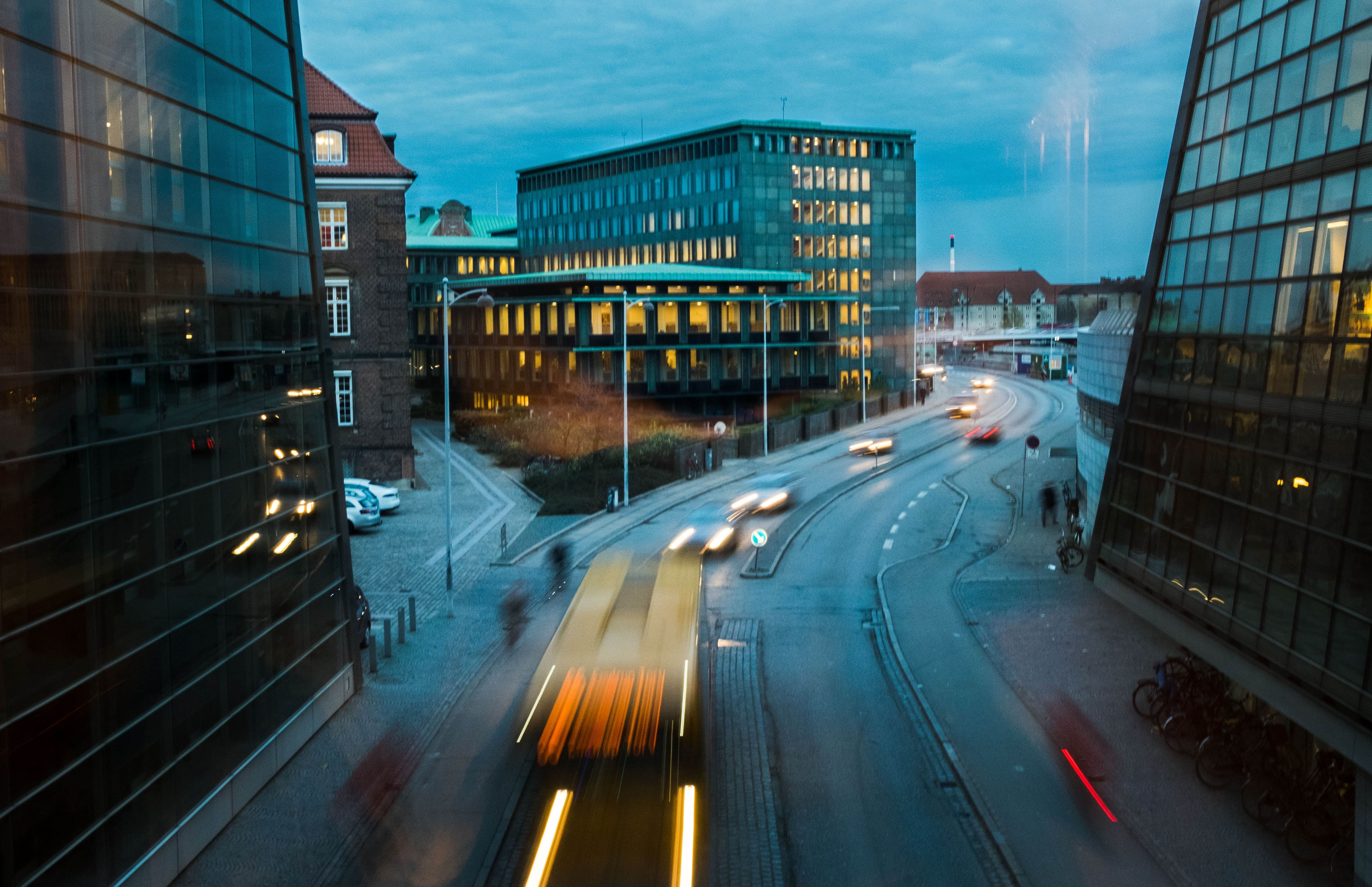 A long exposure shot of the urban nightscape and traffic in Copenhagen.
