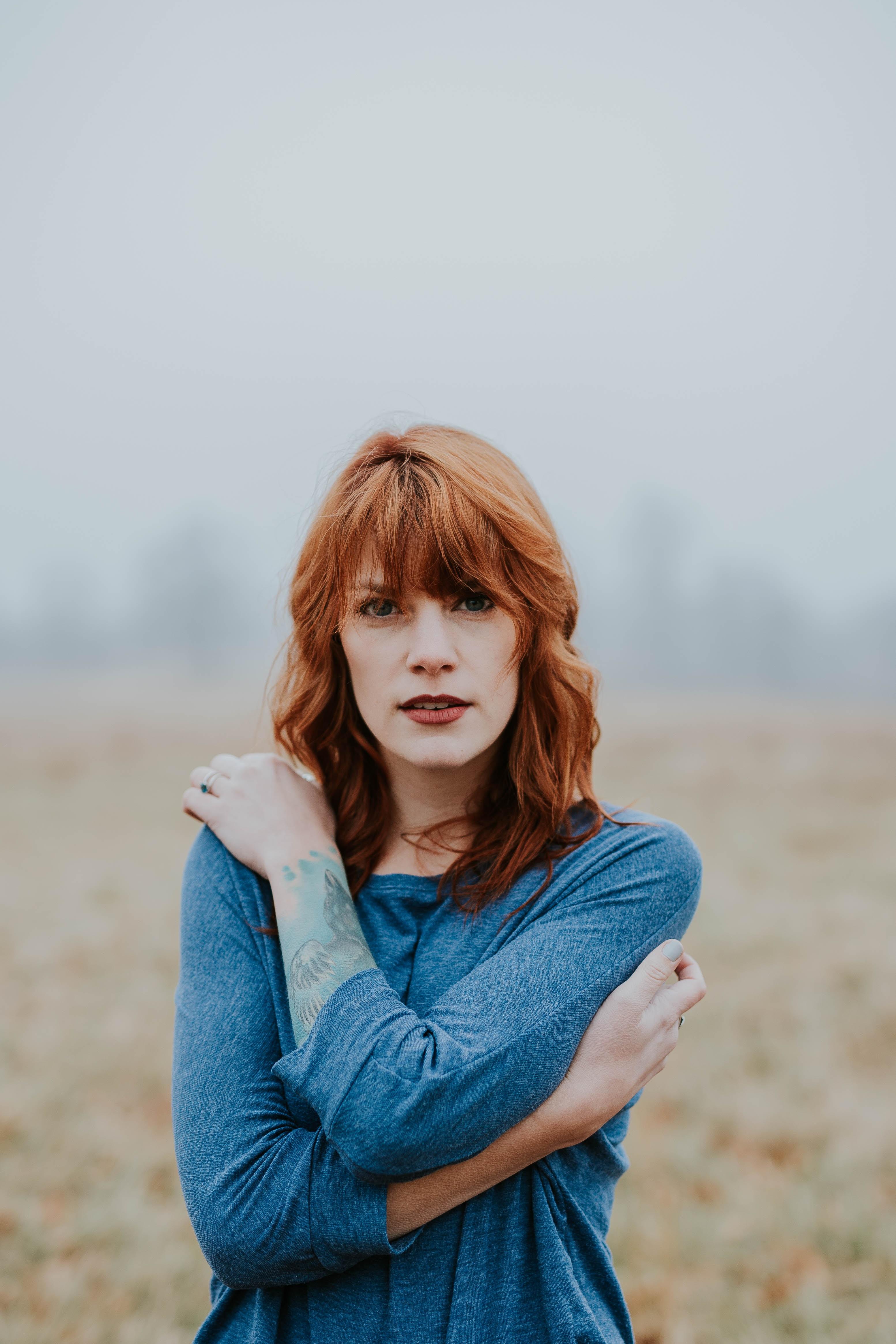 Portrait of woman looking contemplative in a field