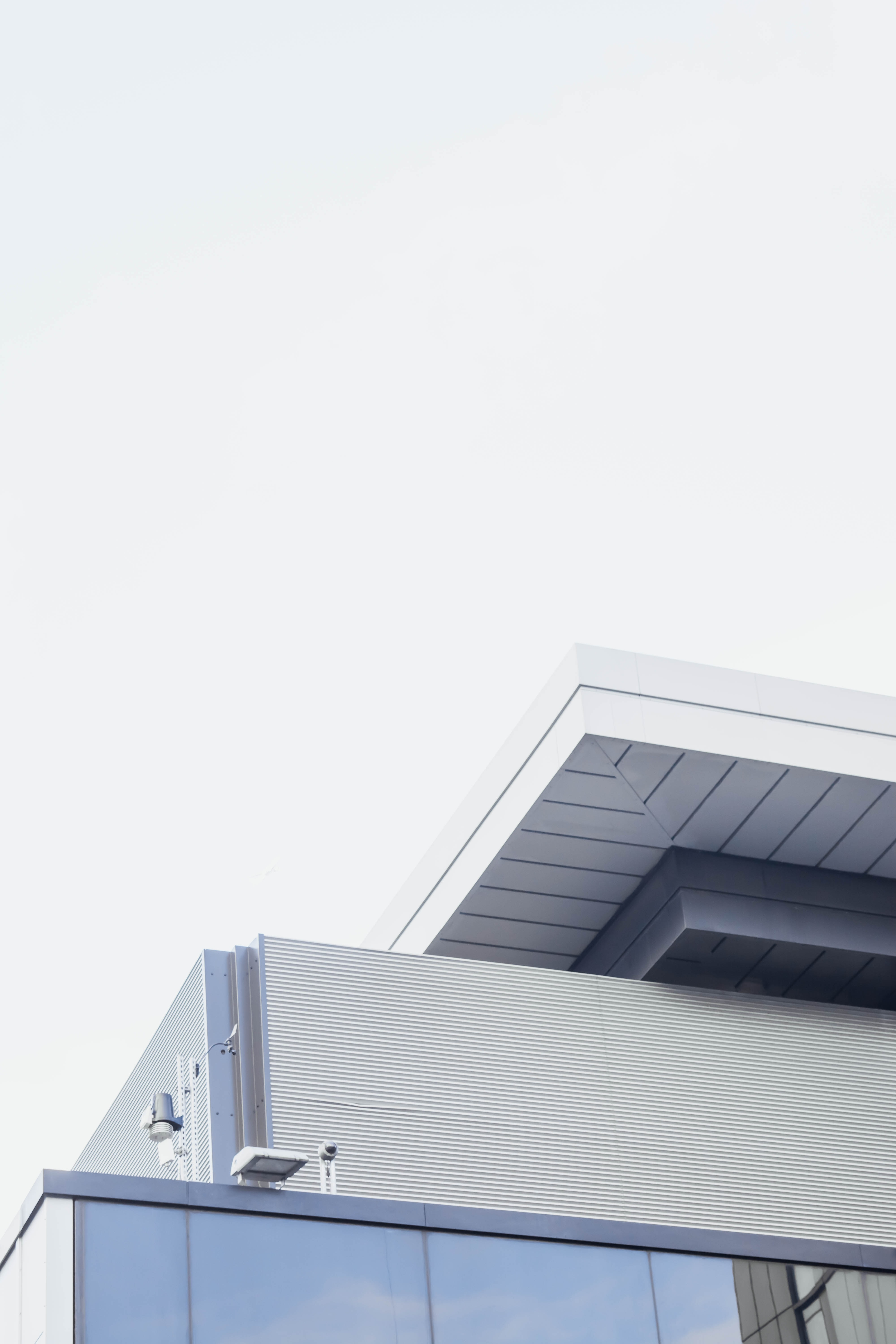 The edge of a modern building with a white roof in London
