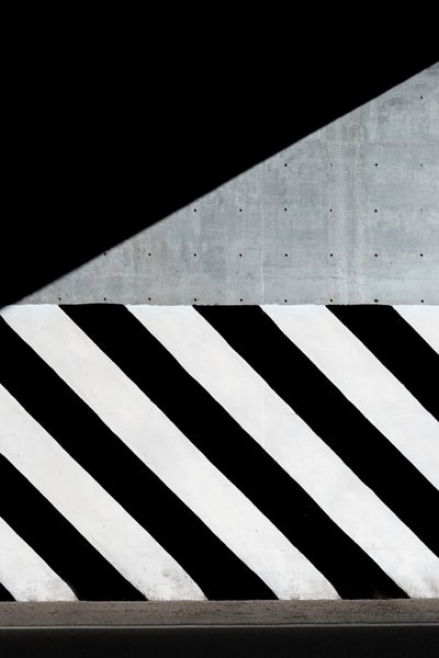 white and black diagonal striped paint on wall