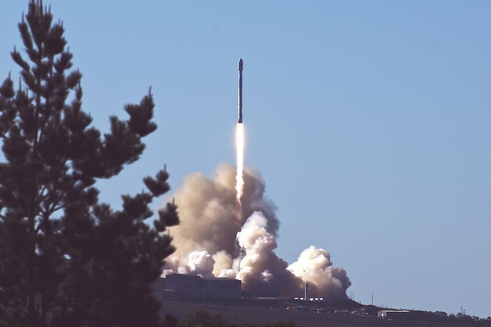 photo of space shuttle launching rocket