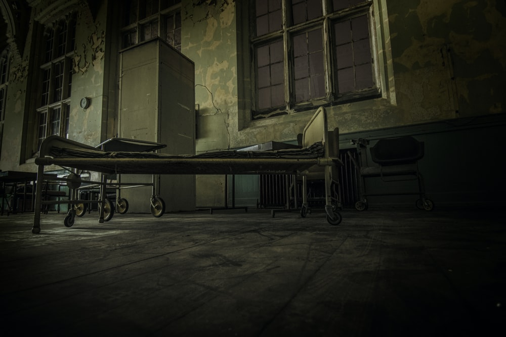 hospital bed on concrete pavement