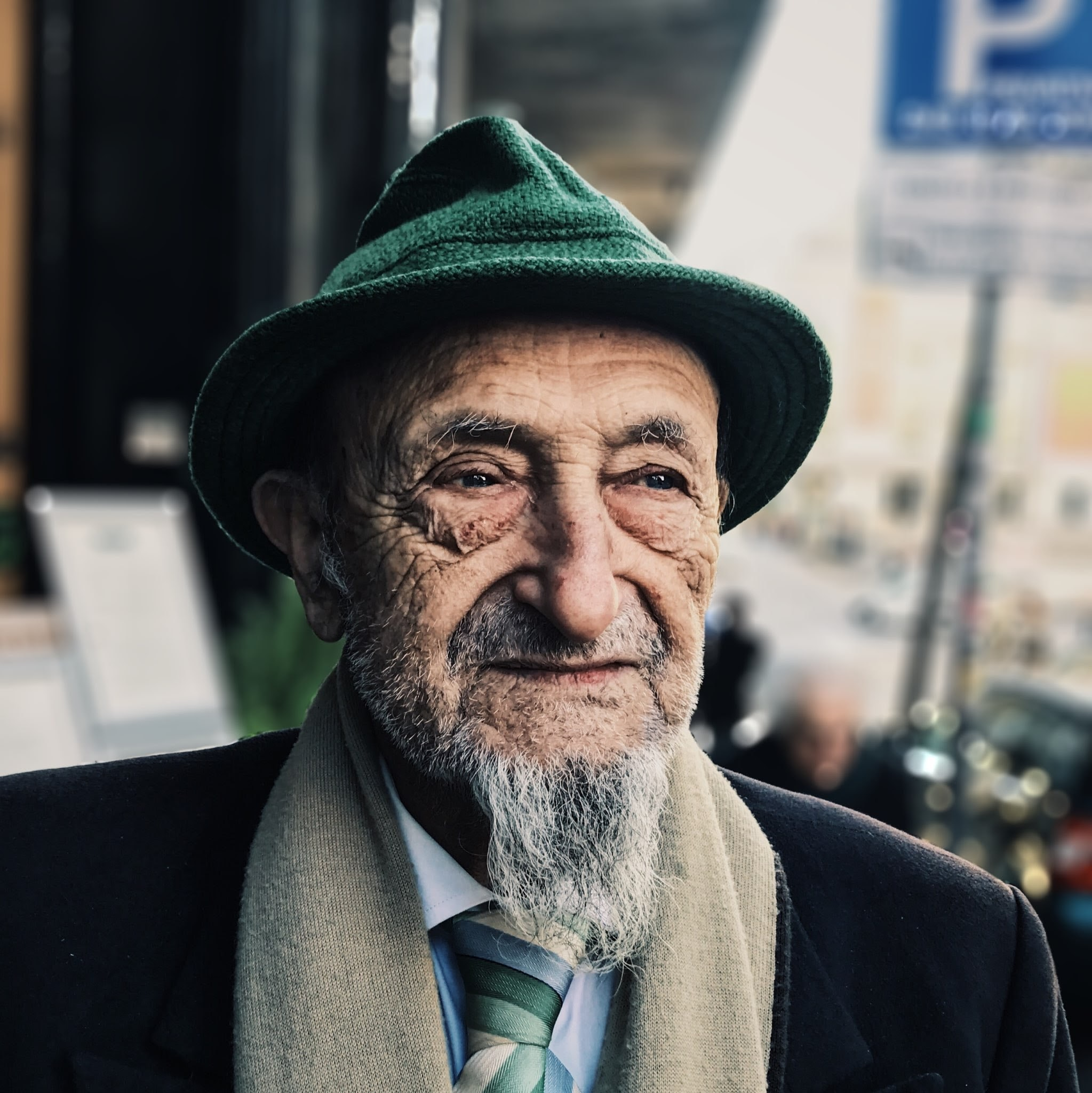 man wearing green hat during daytime