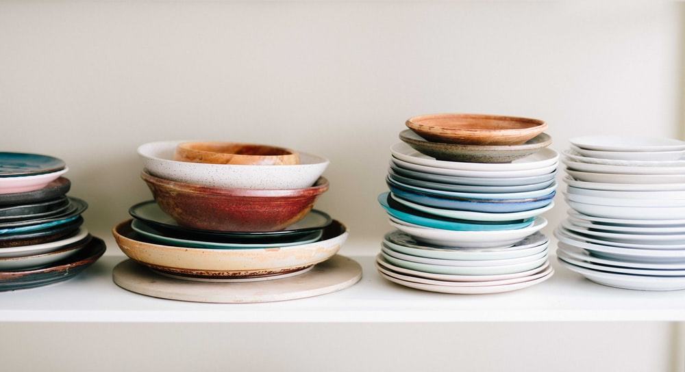 assorted-color ceramic plates and saucers