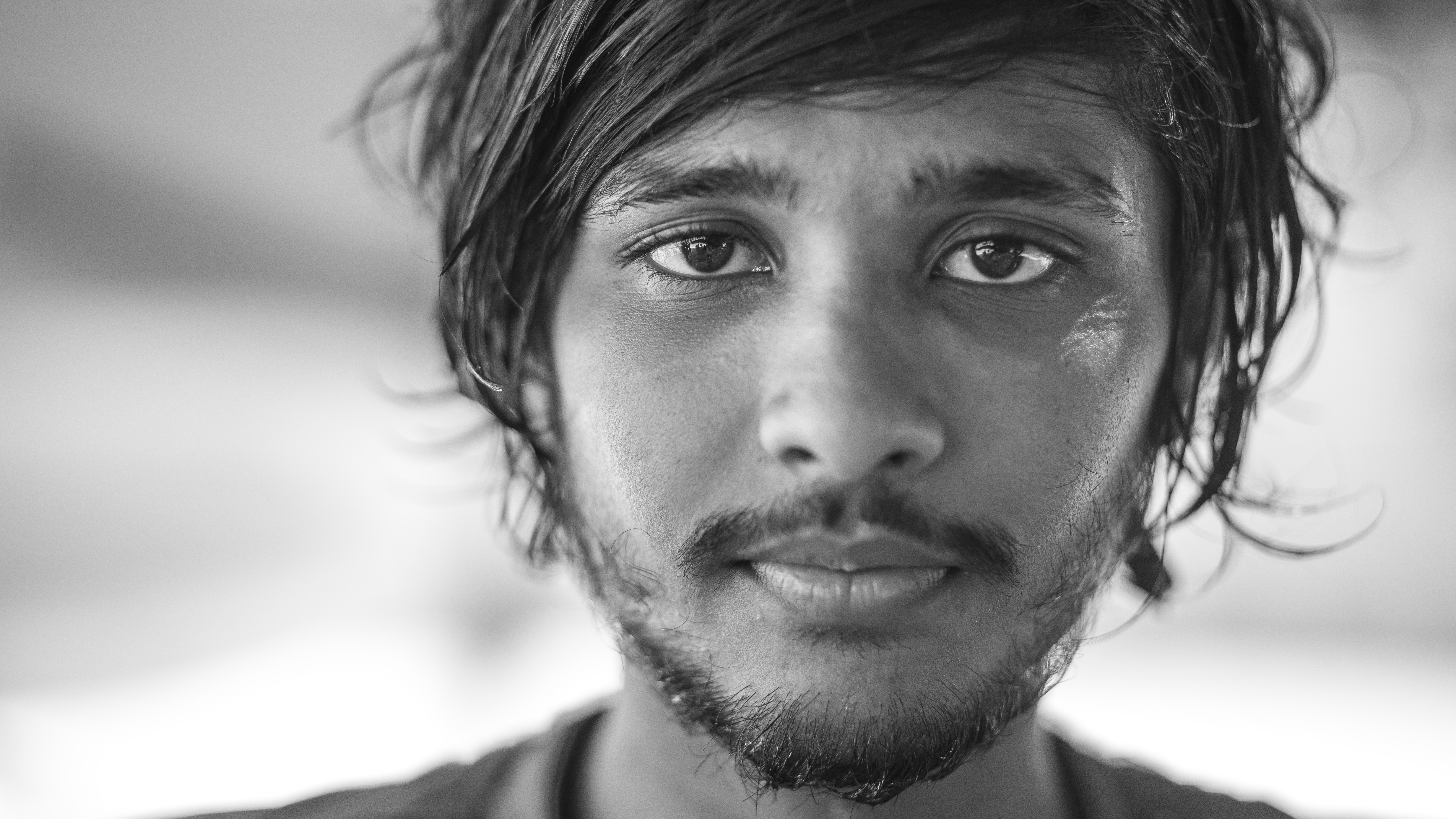 Black and white close up shot of man with facial hair in Gulhi