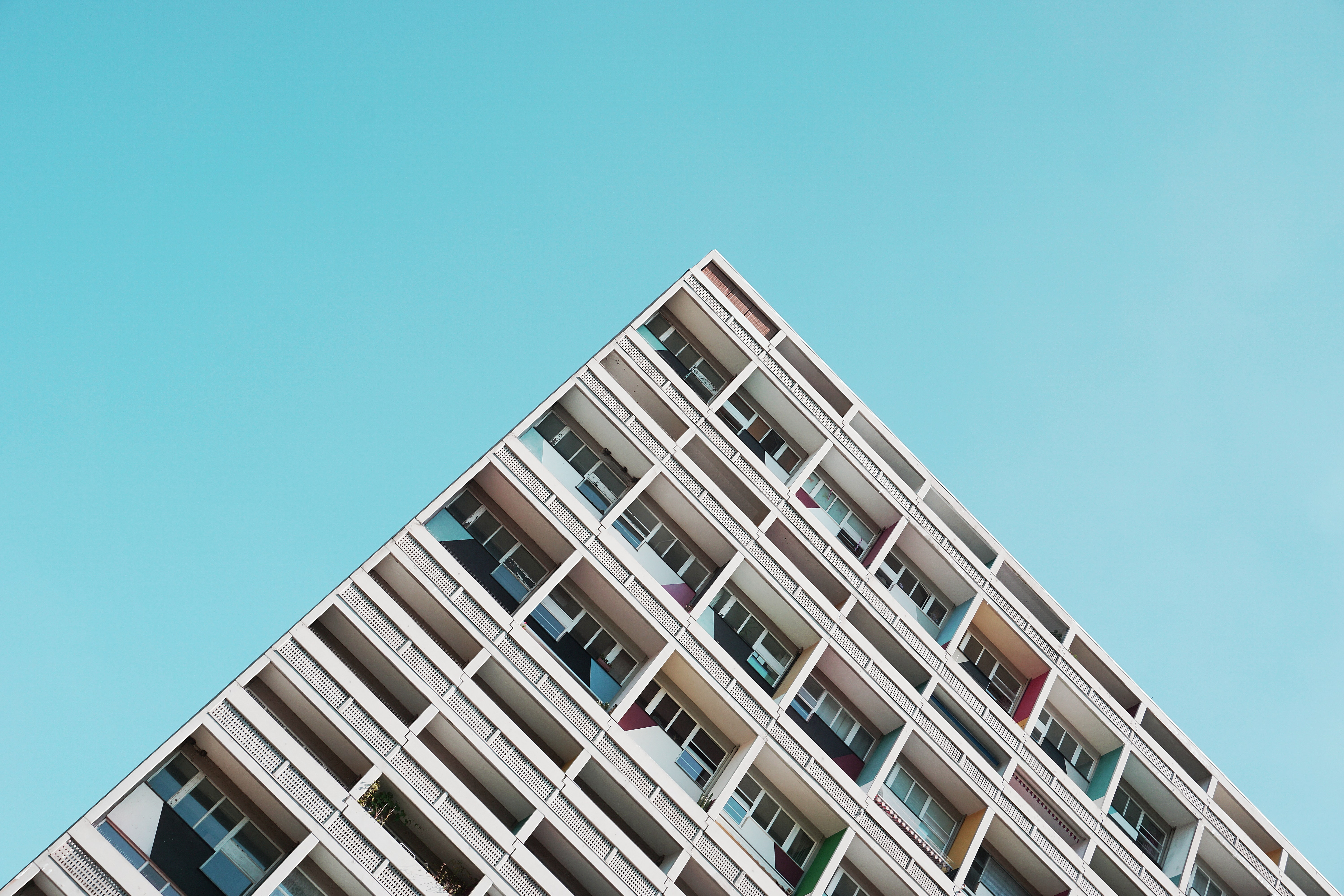 An angular shot of the top edge of a residential building in Berlin