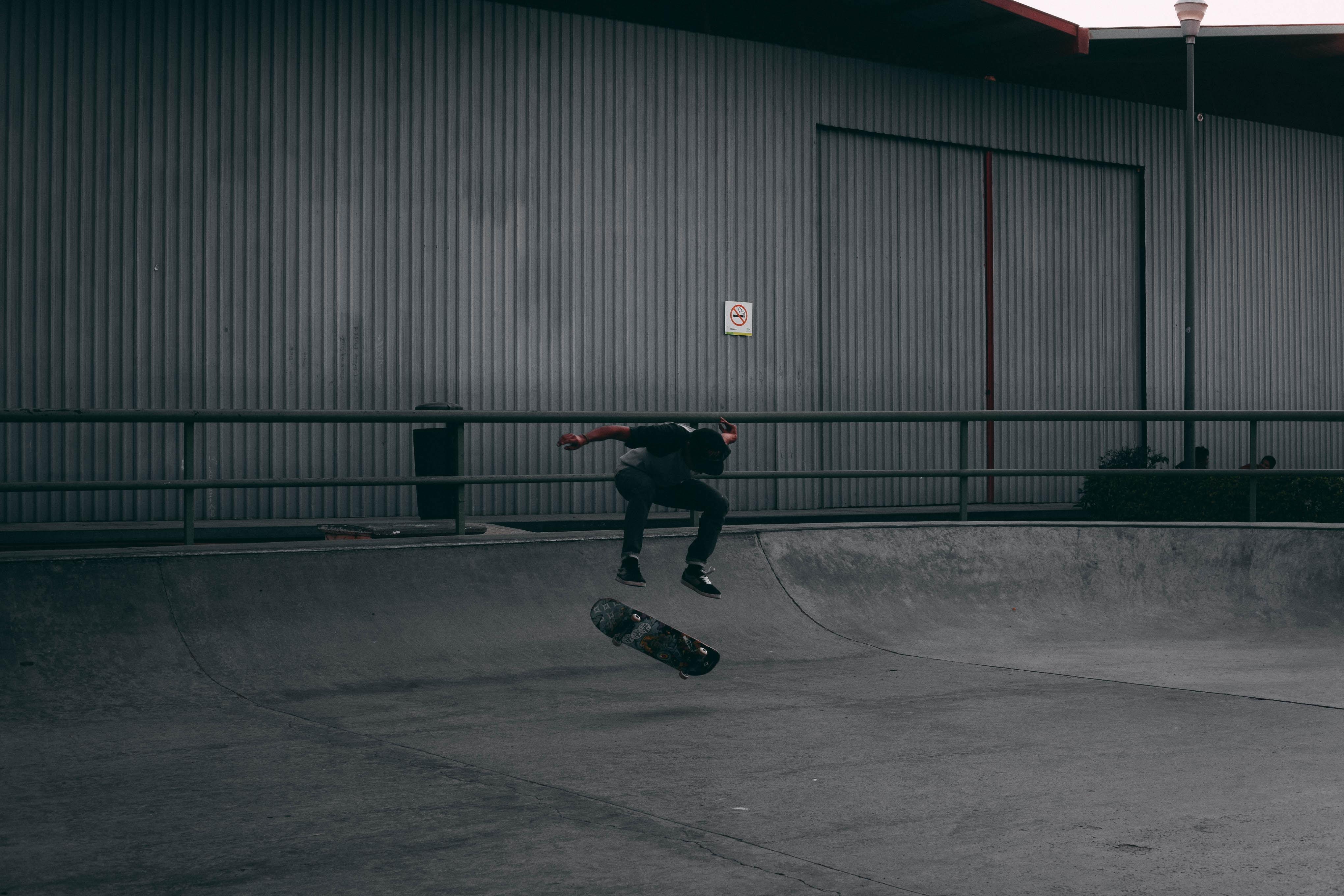 man playing skateboard during daytime