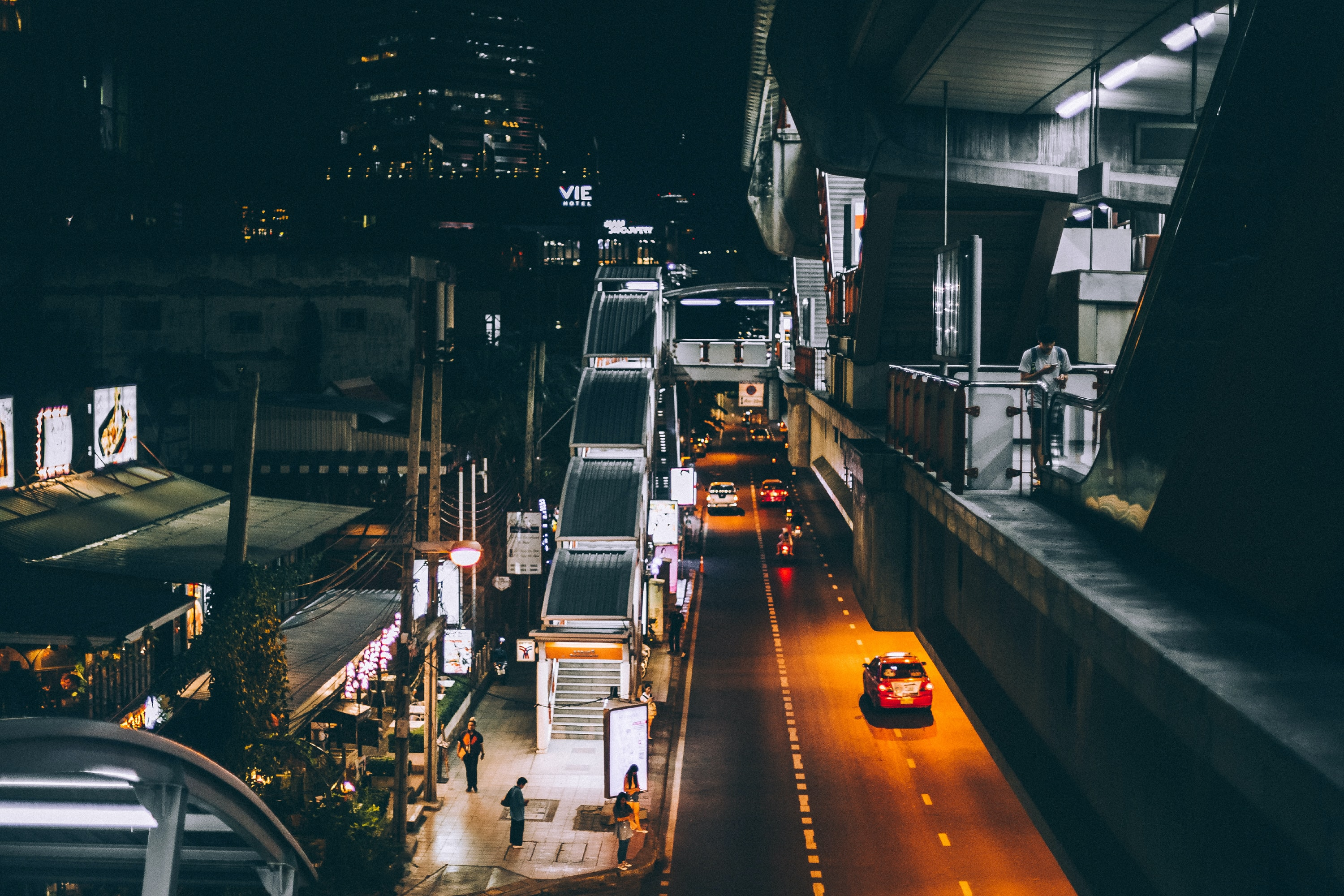 high-angle architectural photography of concrete structure with road on bottom during nighttime