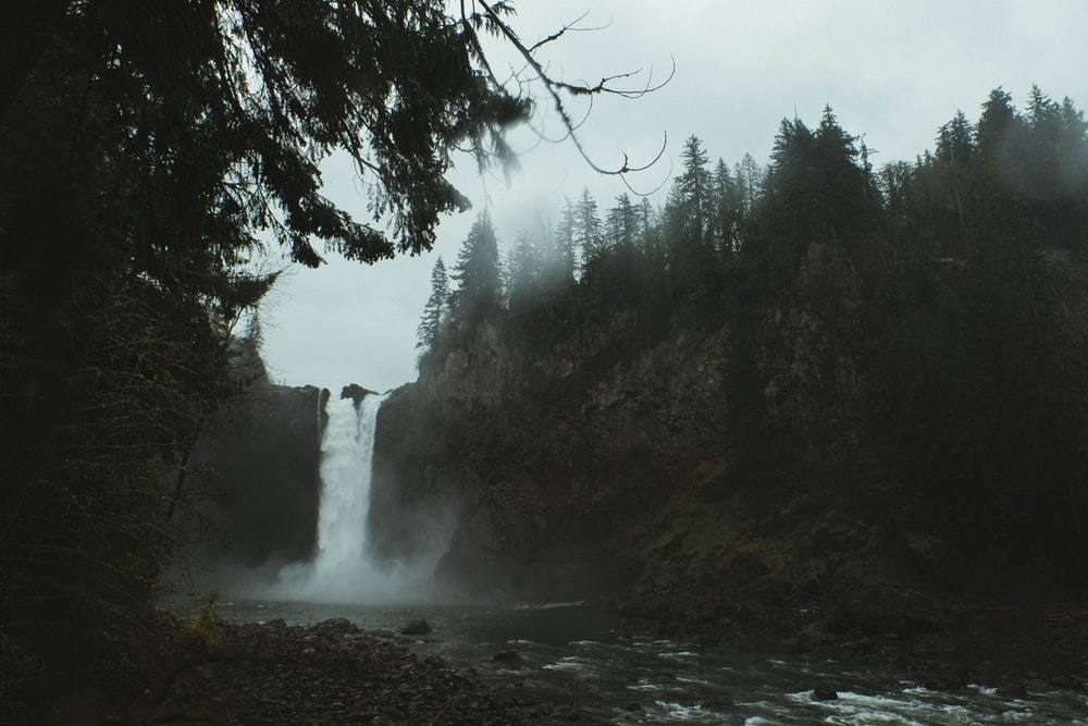waterfalls with fog landscape during daytime