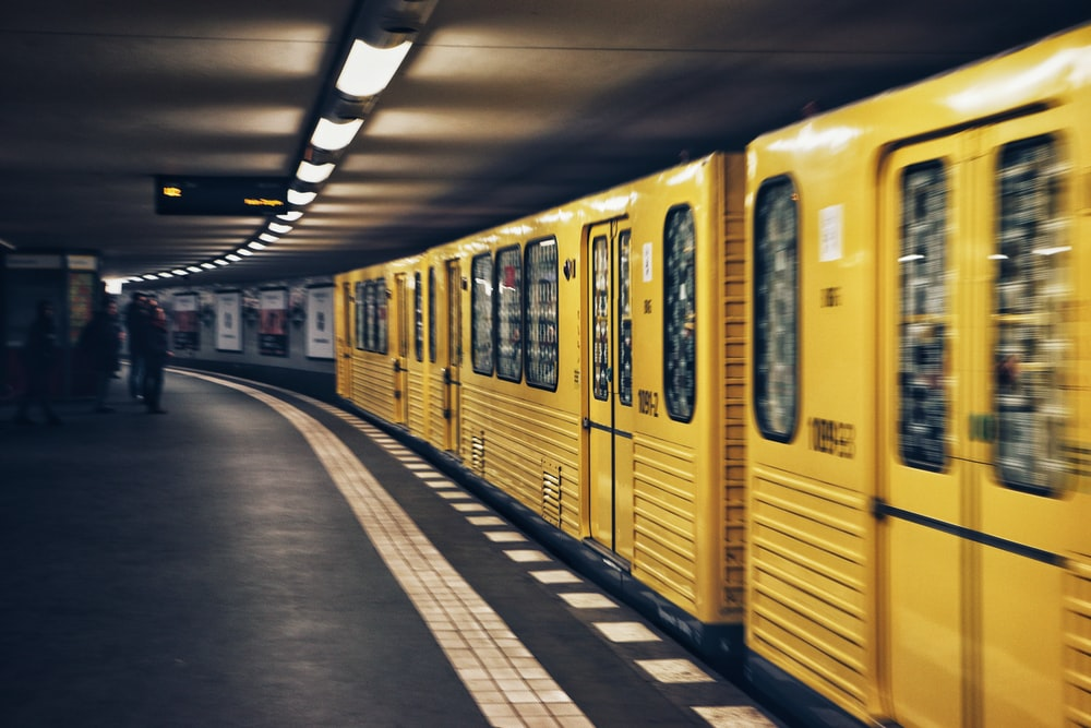 focus photo of yellow train