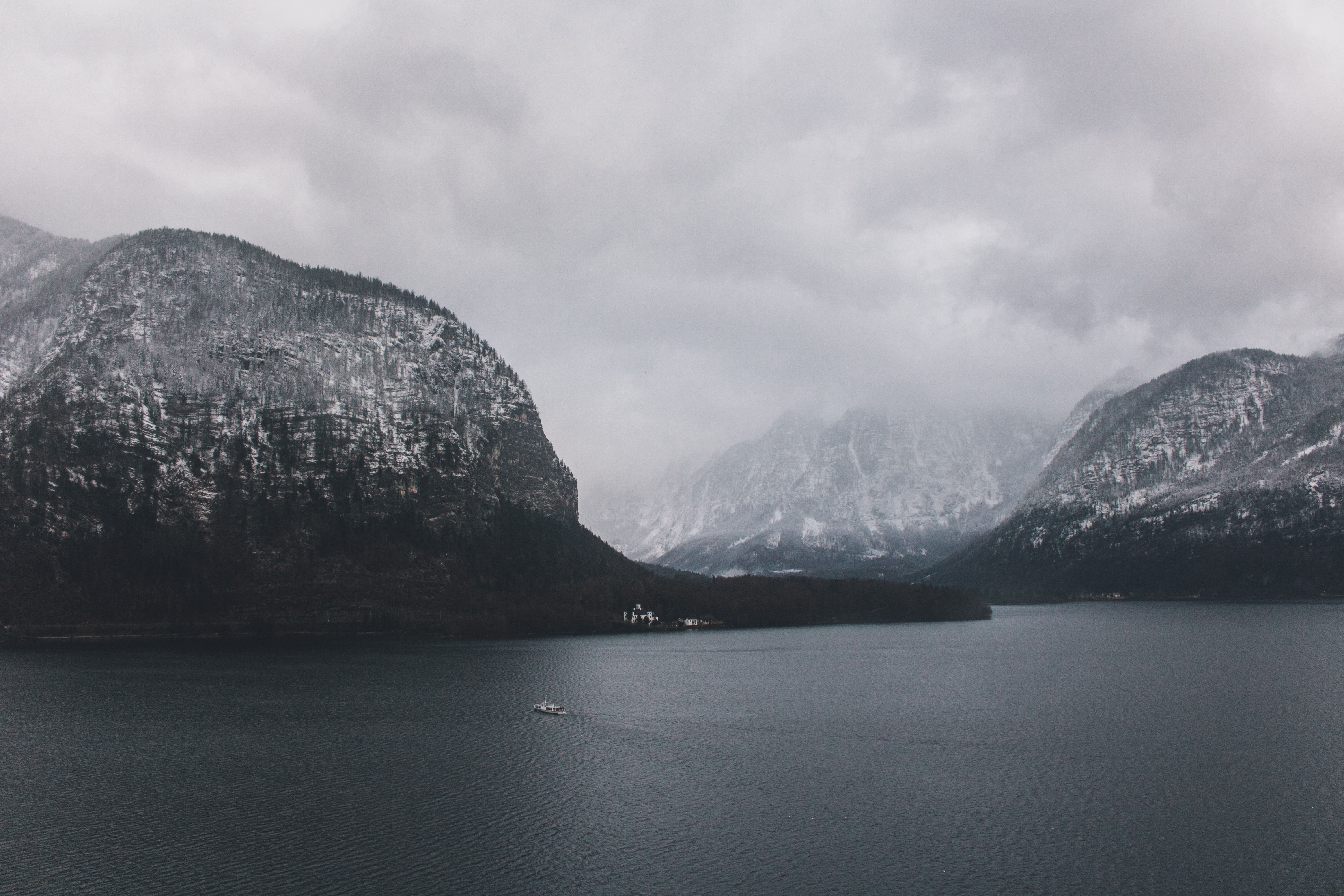mountain surrounded by body of water