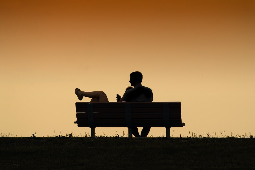 silhouette of couple on the bench painting