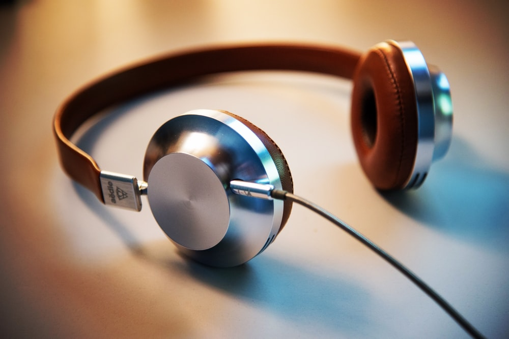gray and brown corded headphones