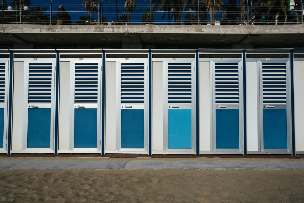 closed silver-and-teal doors