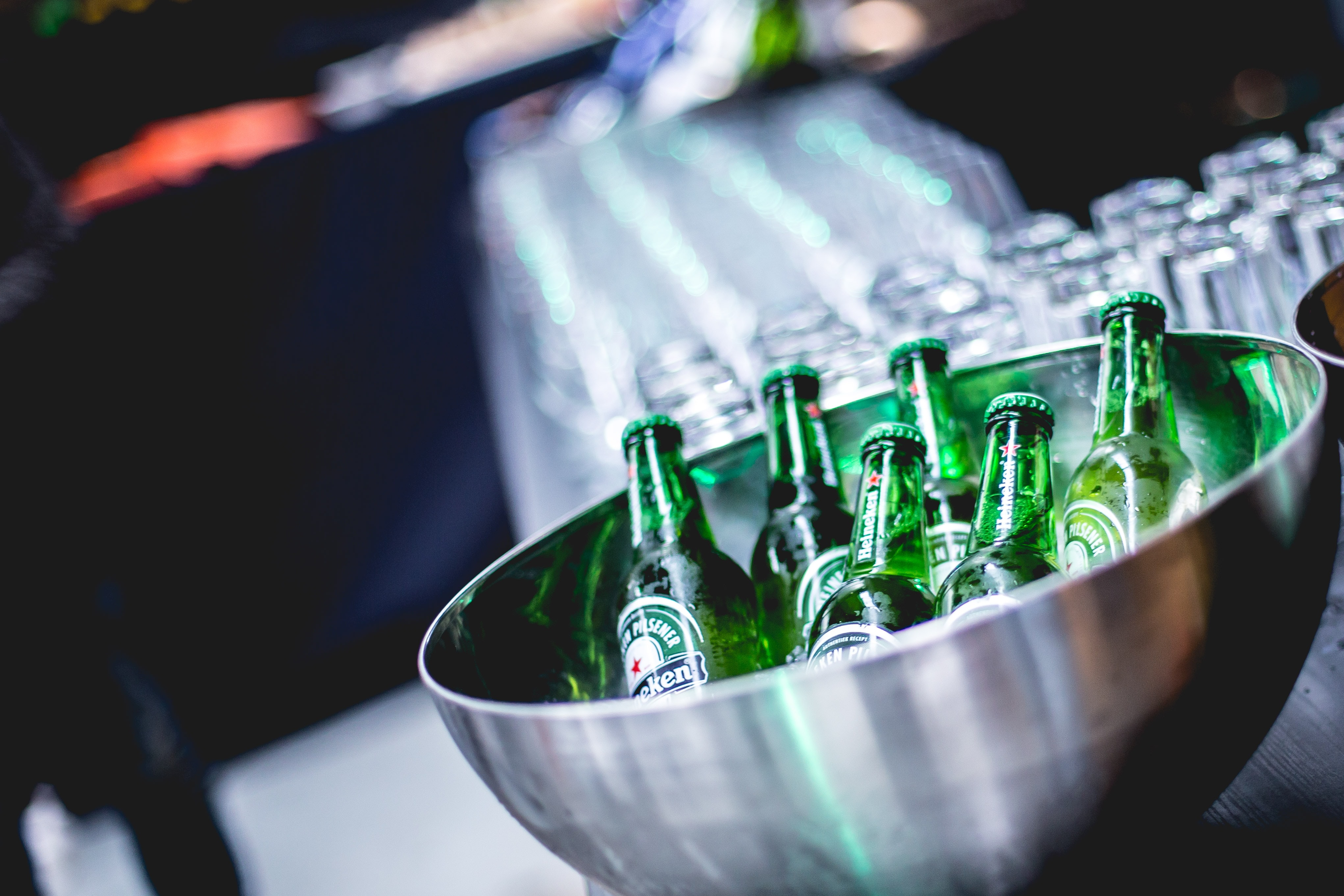 green glass bottles in stainless steel bowl