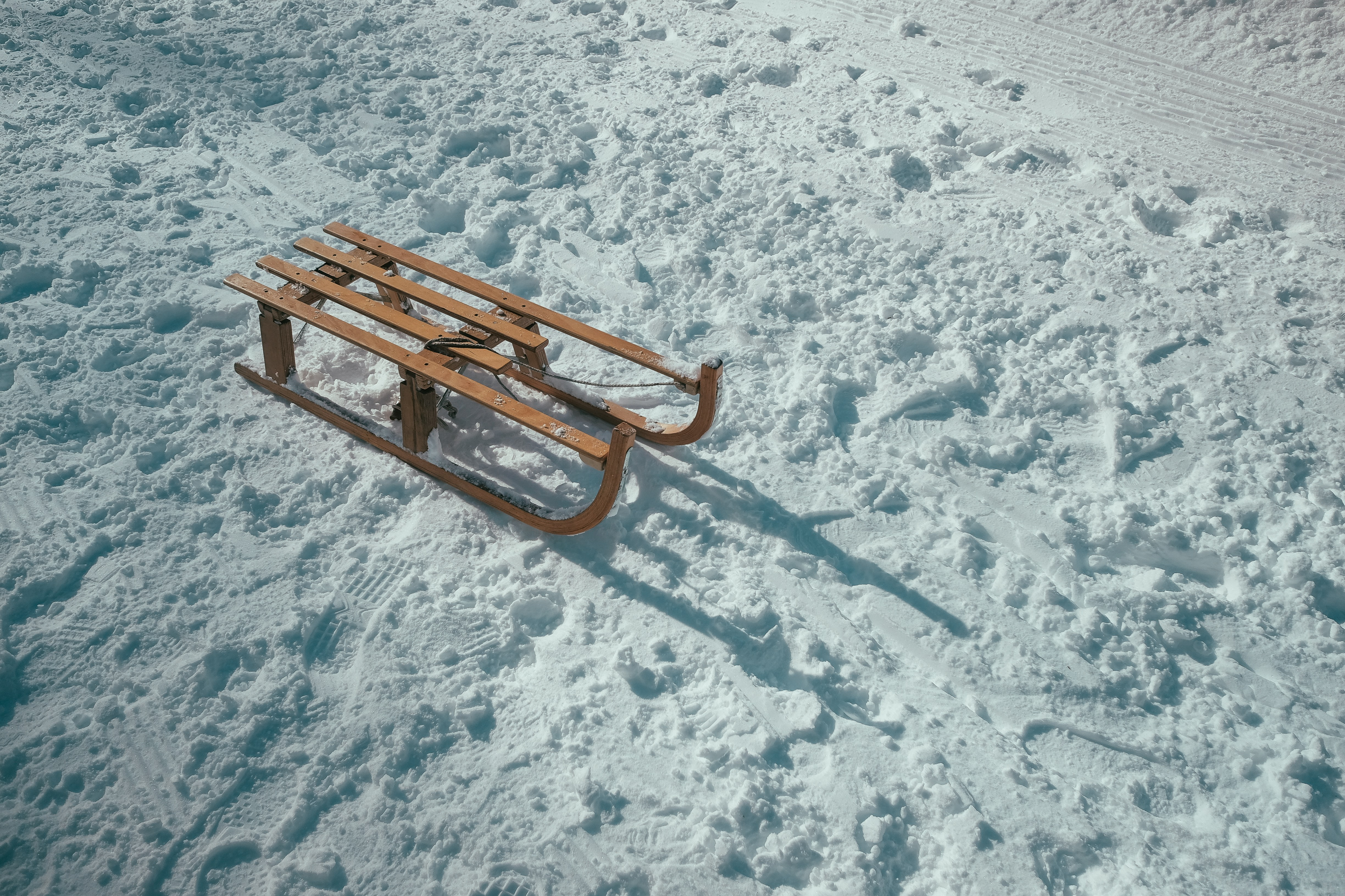 A wooden sled on a snowy hill