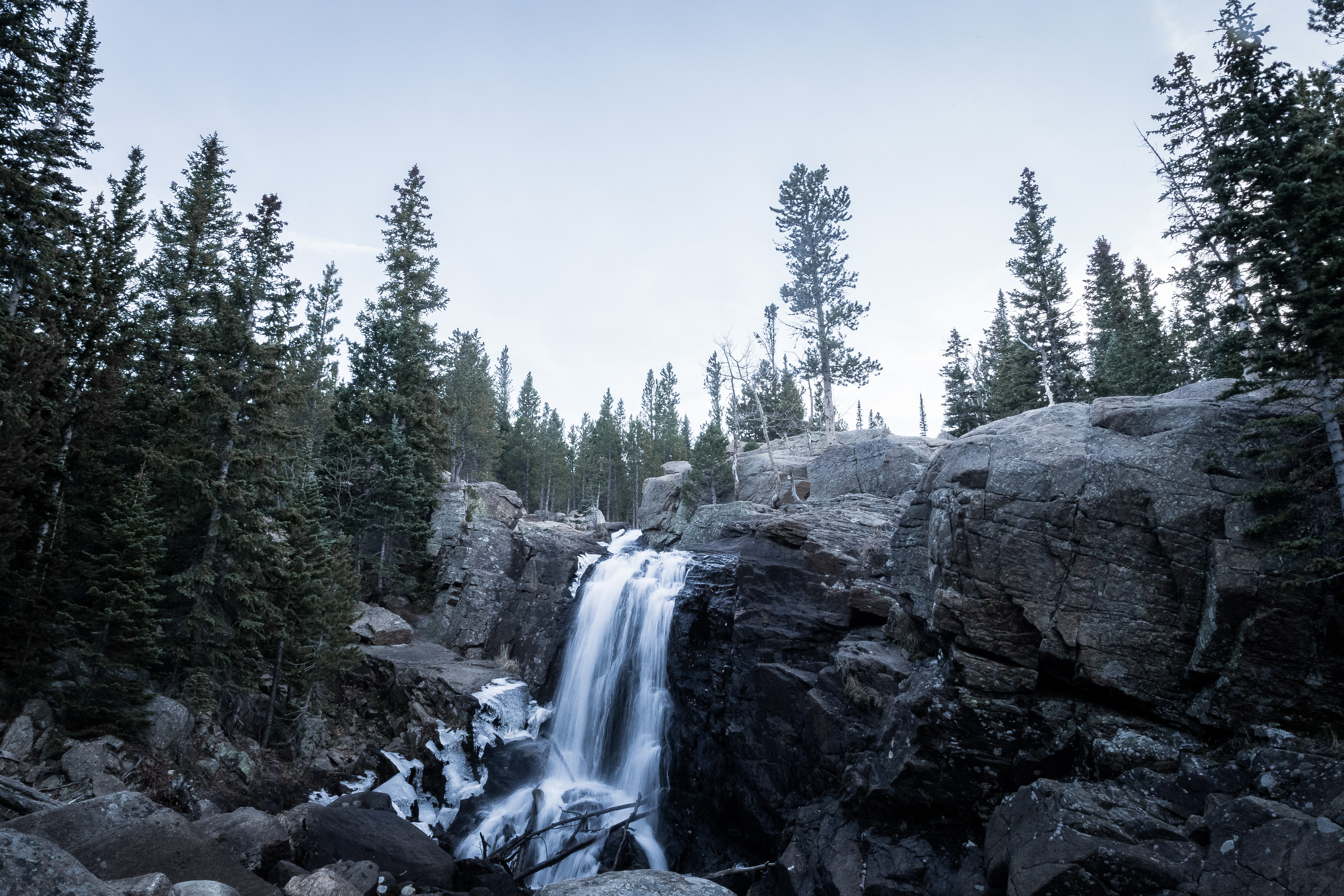 A small waterfall tumbling down jagged rocks