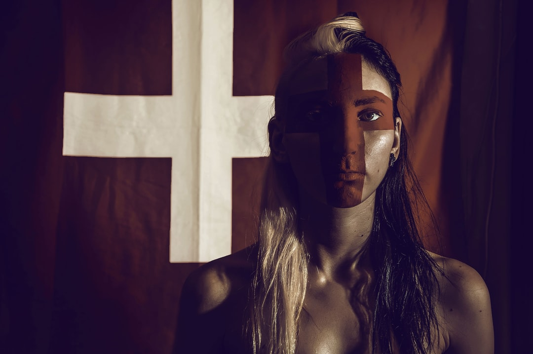 woman with cross flag