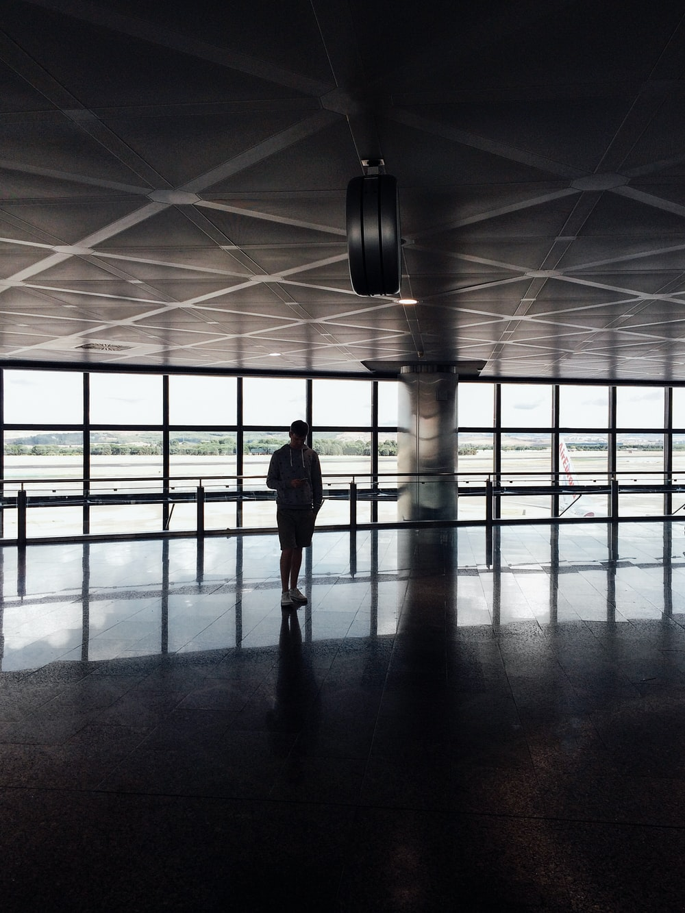 silhouette photo of person inside building