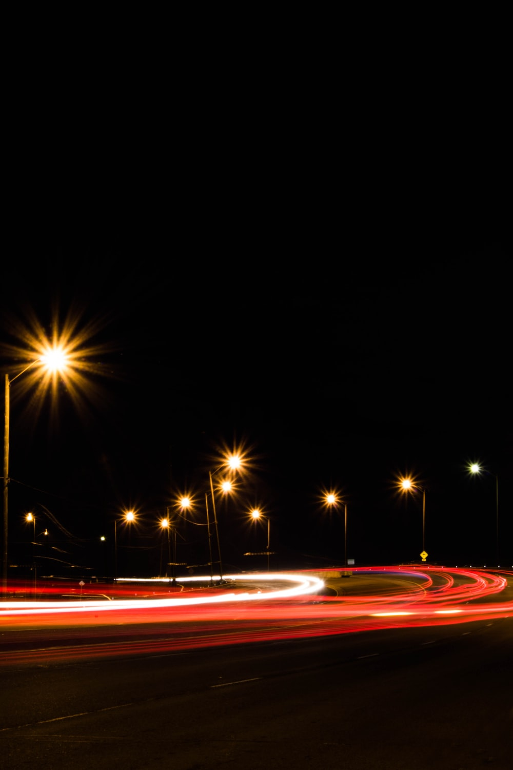 long exposure photography of road during nighttime