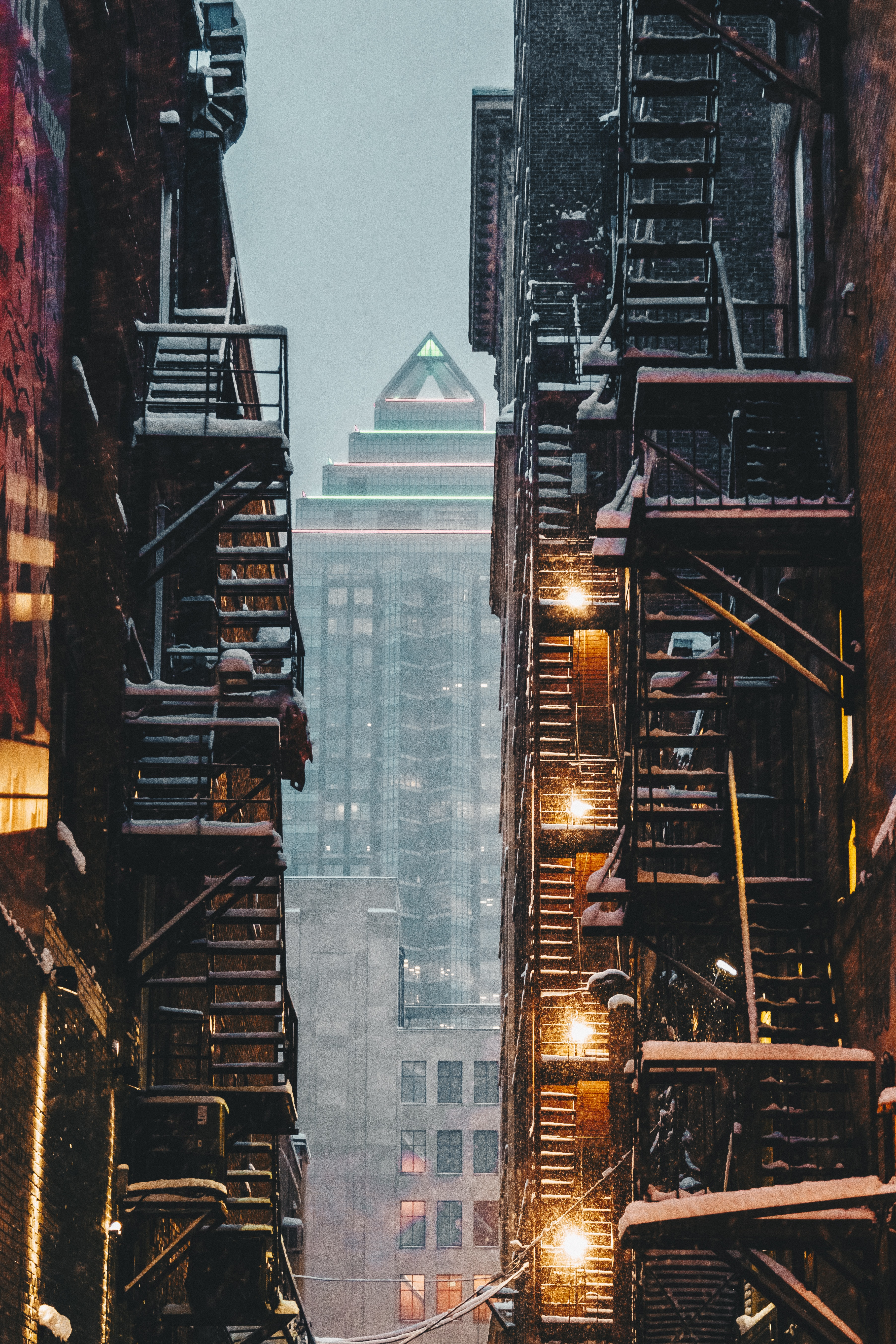 View through an alley of apartment stairwells of a skyscraper downtown in the winter