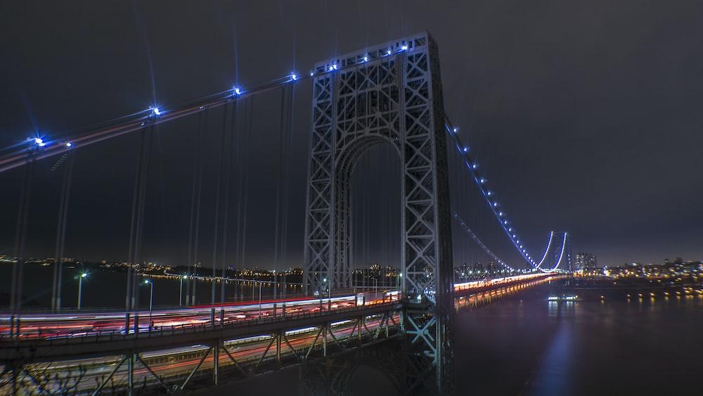 lighted suspension bridge wallpaper